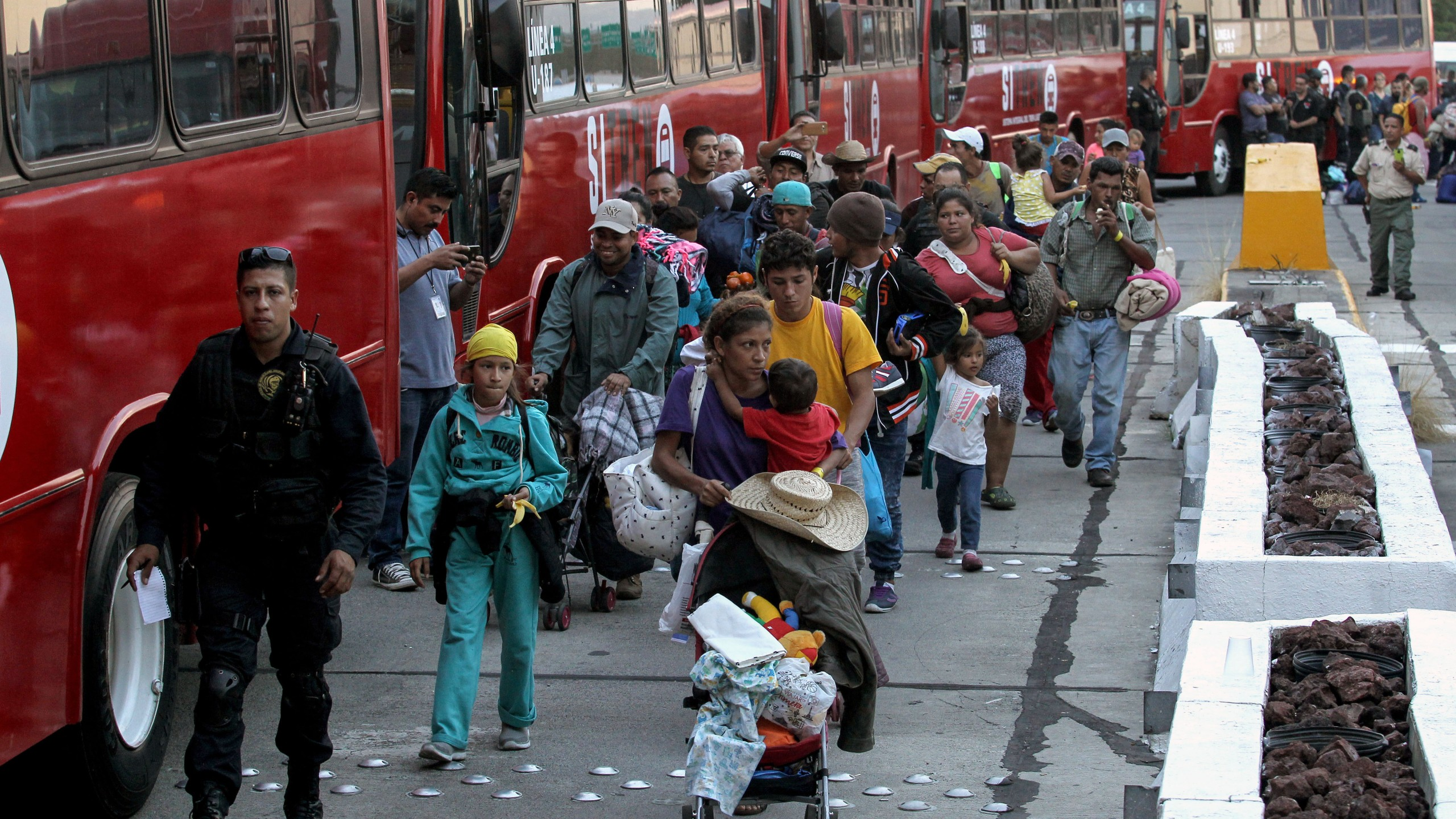 Central American migrants -mostly Hondurans- moving in a caravan towards the United States, board buses to head to a shelter in the outskirts of Zapotlanejo, Jalisco state, Mexico, on Nov. 11, 2018. (Credit: Ulises Ruiz/AFP/Getty Images)