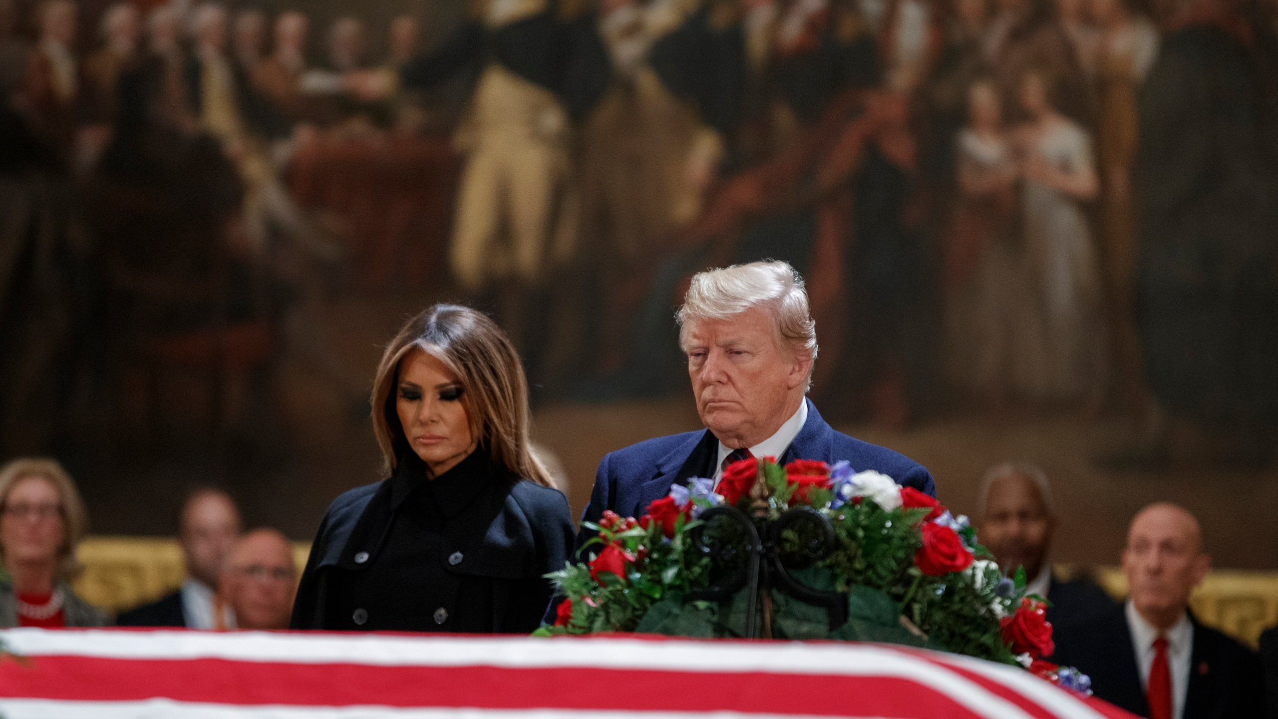 Donald Trump and first lady Melania Trump pay their respects to former President George H.W. Bush as he lies in state in the U.S. Capitol Rotunda on Dec. 3, 2018. (Credit: Shawn Thew-Pool/Getty Images)