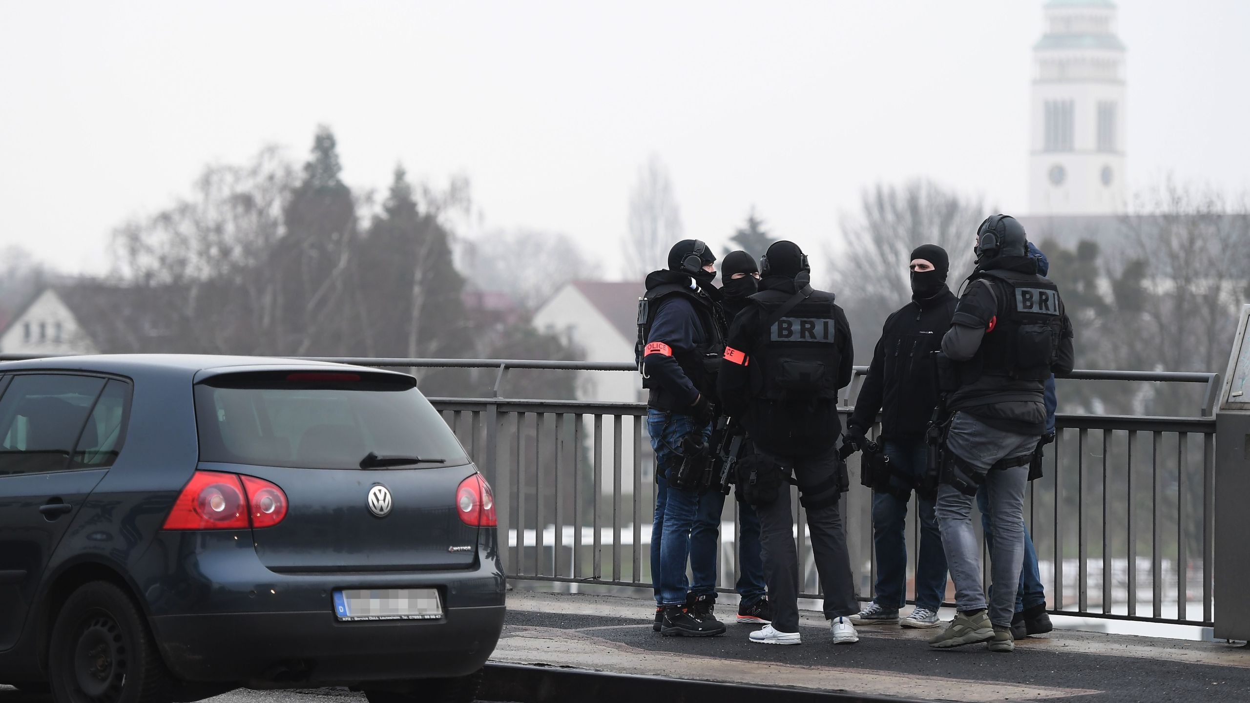 Members of the French police unit BRI stand guard on the Pont de l'Europe crossing the border with Germany over the river Rhine in Strasbourg, on Dec. 12, 2018, during a search for a gunman who opened fire near a Christmas market the night before. (Credit: FREDERICK FLORIN/AFP/Getty Images)