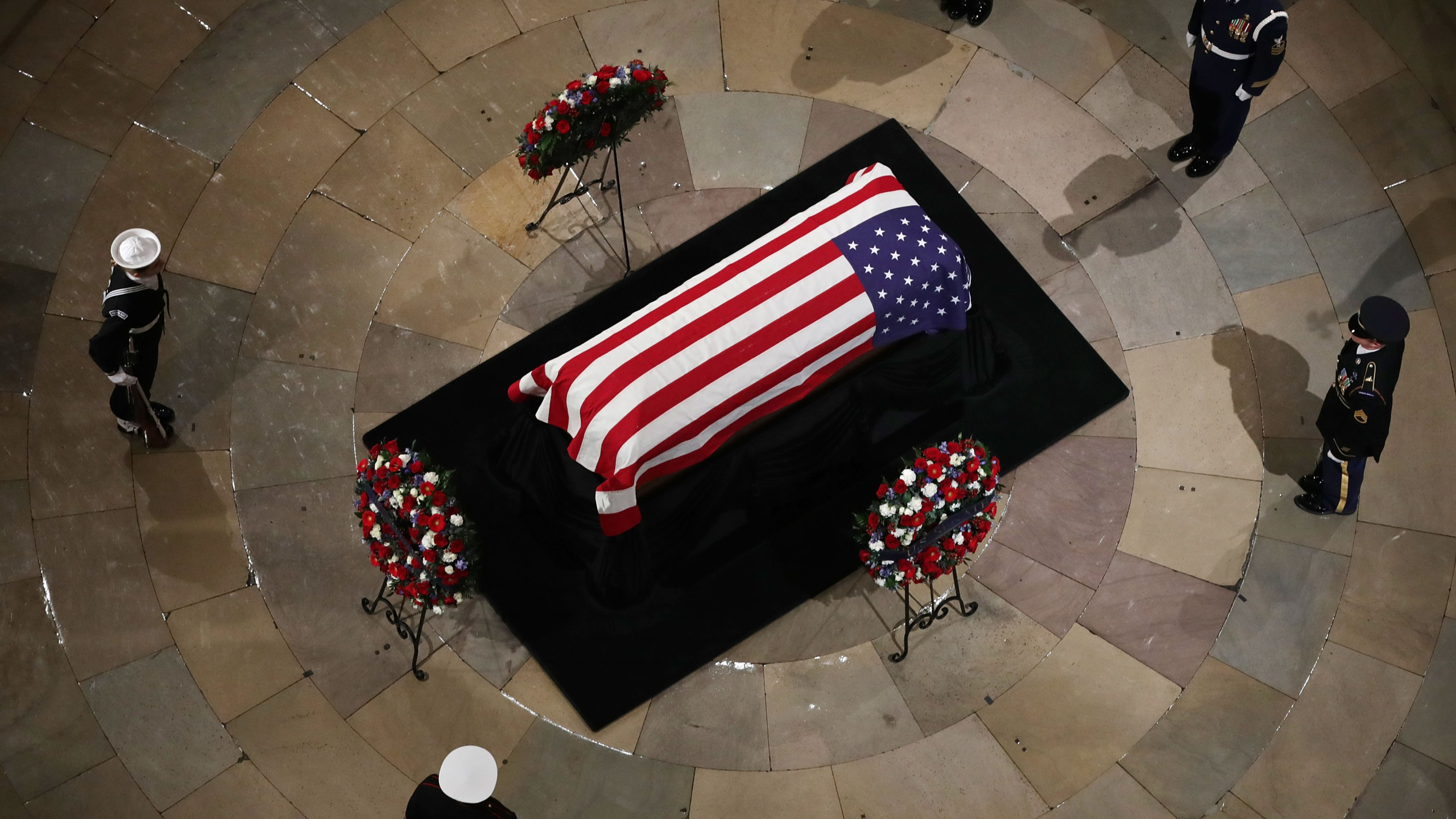 A U.S. military honor guard stands watch as former U.S. President George H.W. Bush lies in state in the U.S. Capitol Rotunda December 03, 2018 in Washington, DC. (Credit: Chip Somodevilla/Getty Images)