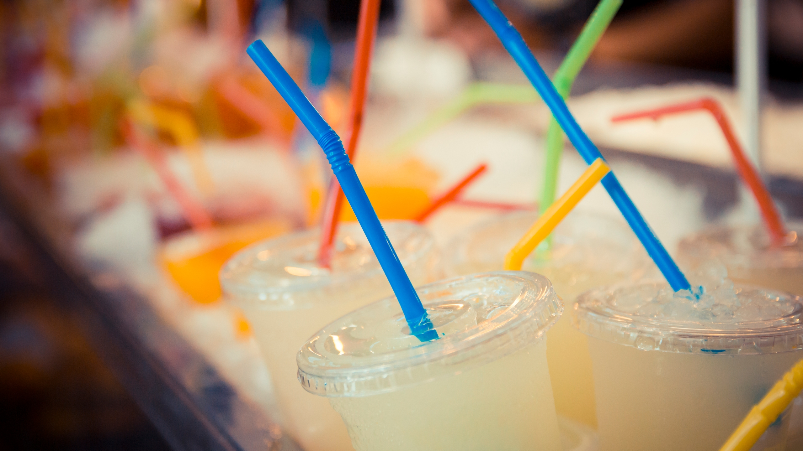 Plastic straws in plastic cups are seen in a file photo. (Credit: iStock / Getty Images Plus)