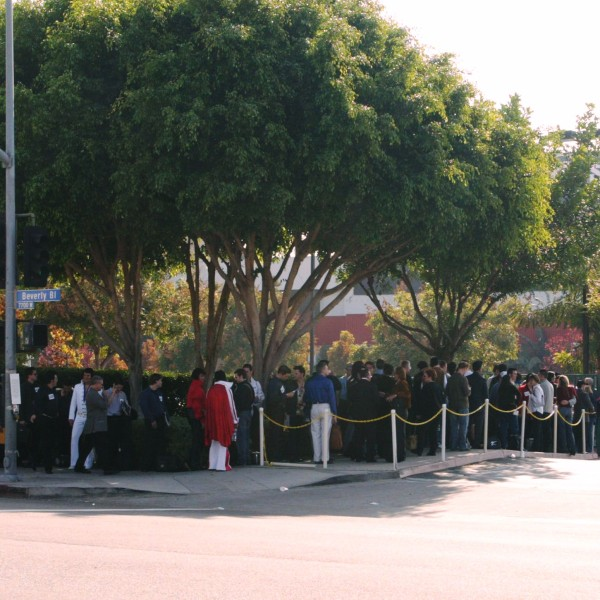 """Participants wait in line outside CBS Television City for tryouts during the """"Elvis"""" opening casting call on Oct. 10, 2004. (Credit: Frederick M. Brown / Getty Images)"""