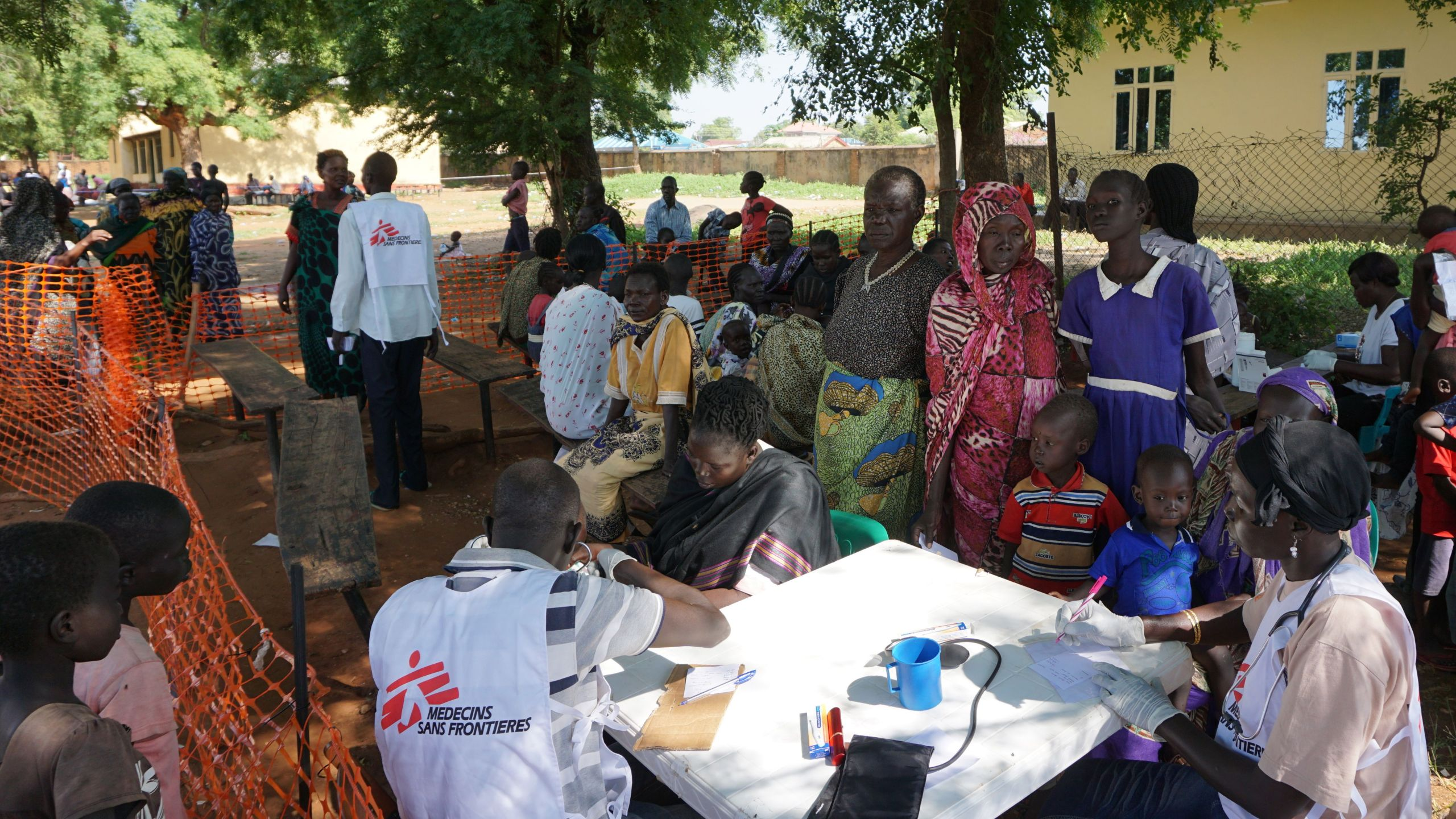 Medics from aid agency Doctors Without Borders (MSF) treat patients at a makeshift clinic in the grounds of the Catholic Cathedral in the South Sudanese capital Juba on July 15, 2016, after days of fighting left hundreds dead and forced thousands to flee their homes. (Credit: PETER MARTELL/AFP/Getty Images)