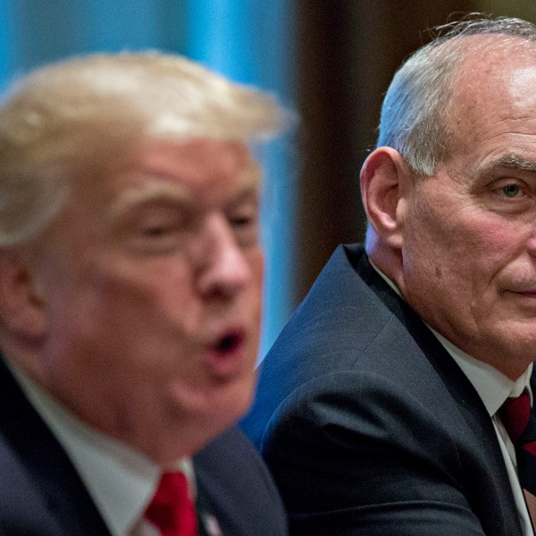 John Kelly listens as Donald Trump speaks at a briefing with senior military leaders in the Cabinet Room of the White House on Oct. 5, 2017 in Washington, D.C. (Credit: Andrew Harrer-Pool/Getty Images)