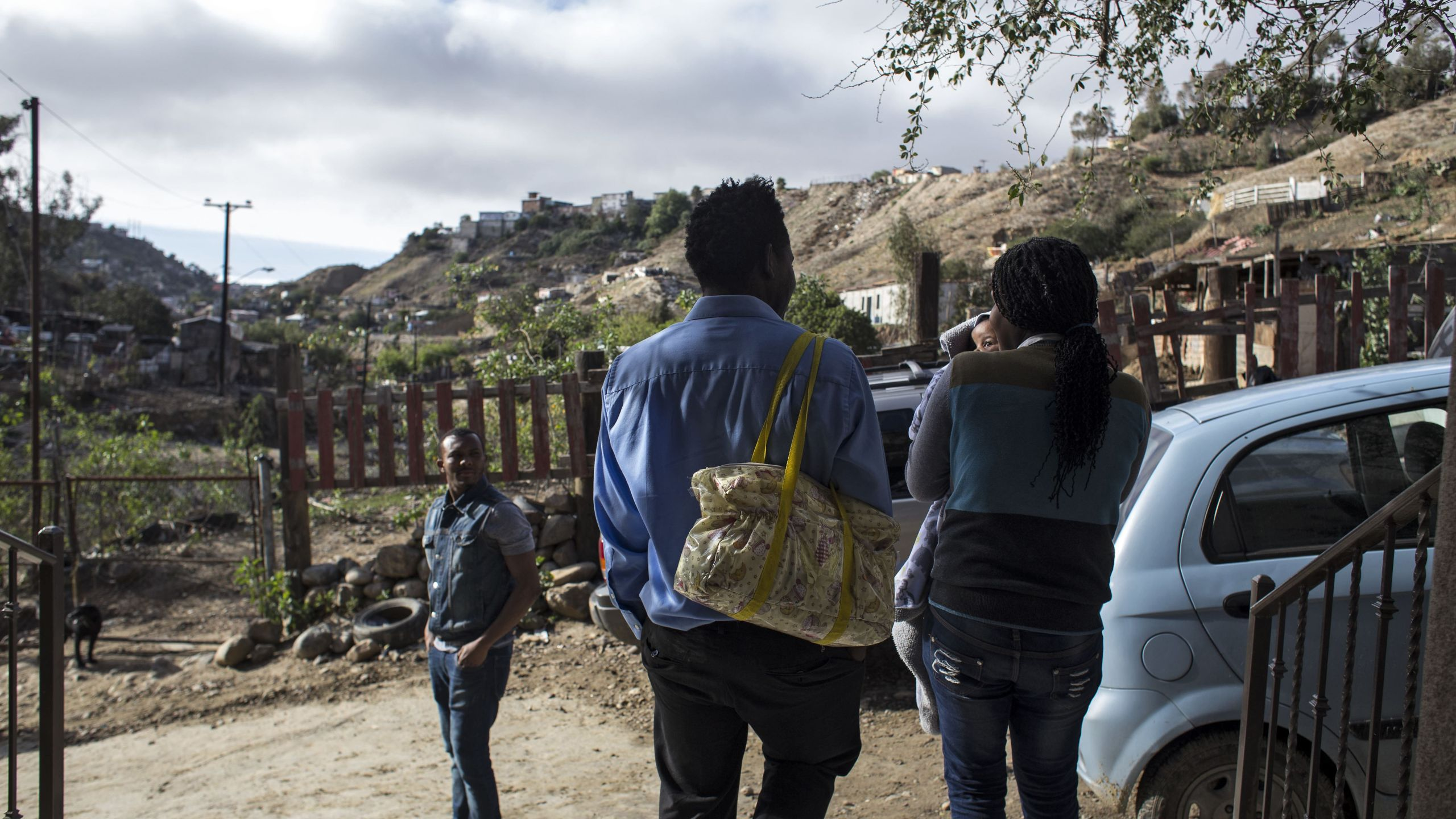 A Haitian family leaves after a Sunday mass at the Embajadores de Jesus church, in the suburbs of Tijuana, Mexico on March 11, 2018. (Credit: GUILLERMO ARIAS/AFP/Getty Images)