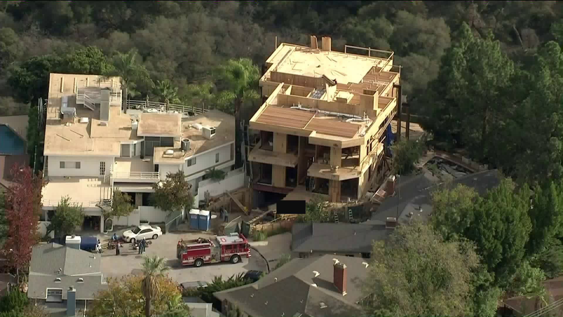 A worker died in an accident at a residential construction site in Bel Air on Dec. 17, 2018. (Credit: KTLA)