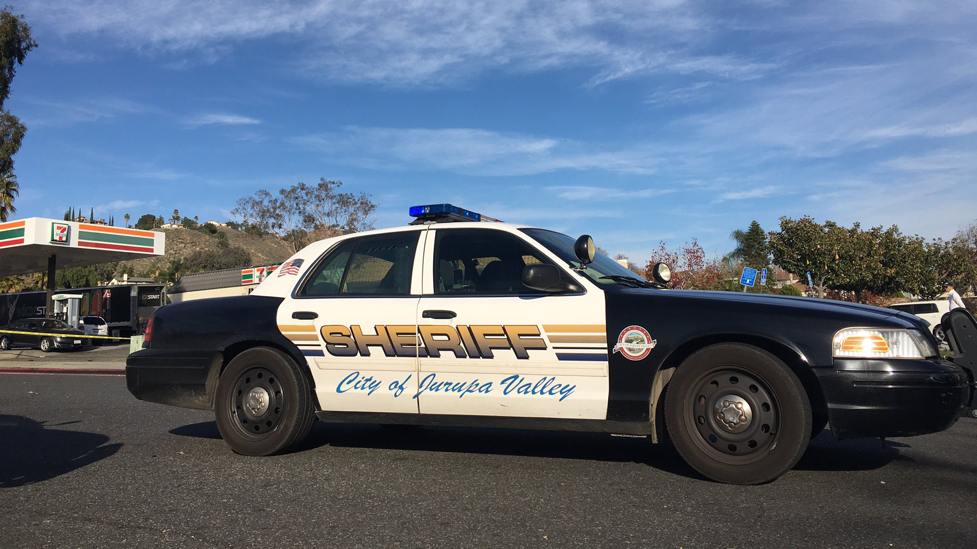 A Riverside County sheriff's vehicle is seen at the scene in Jurupa Valley where a deputy fired shots at suspects on Dec. 26, 2018, in a photo released by the department.
