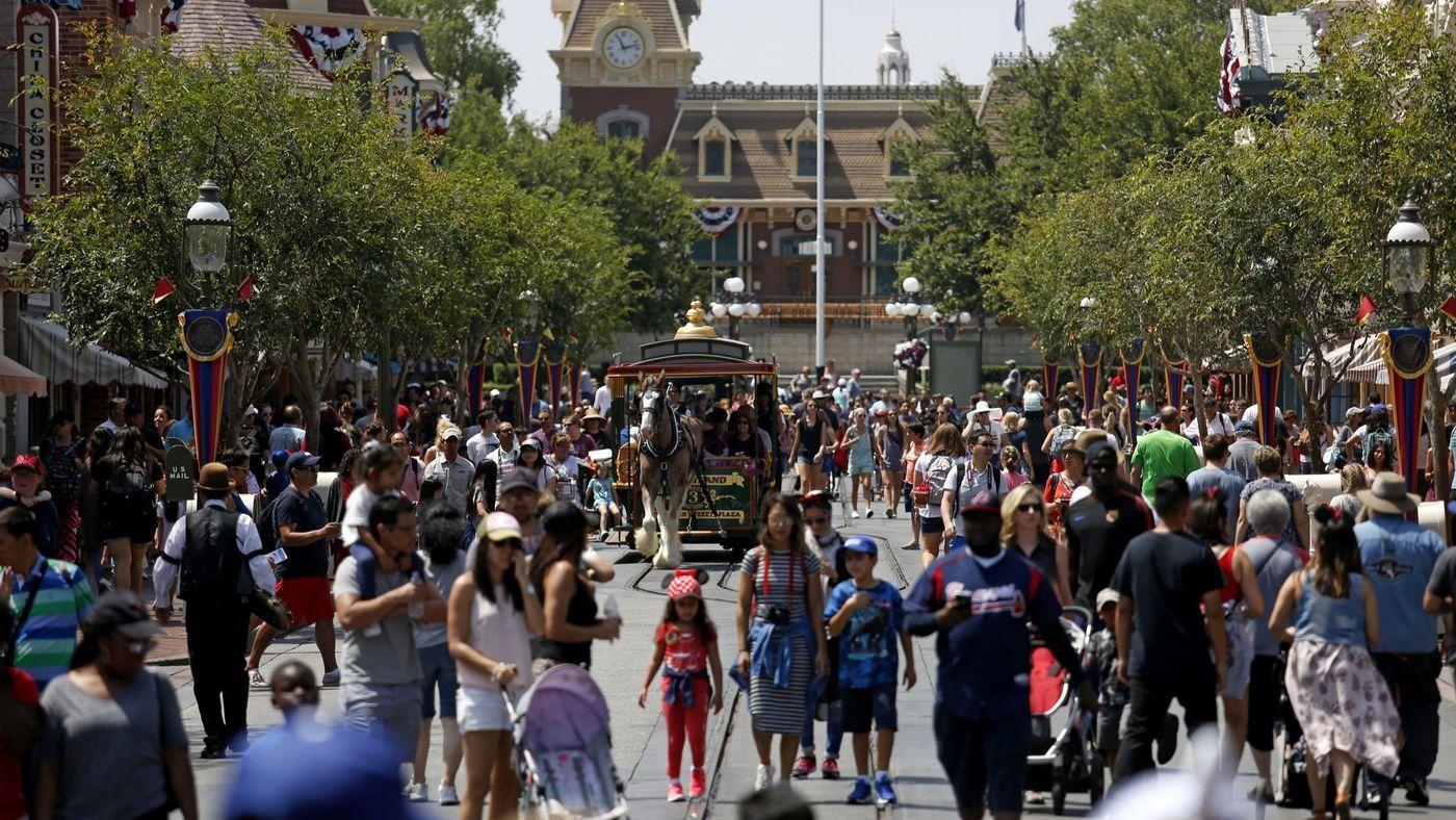 Guests are seen walking along Main Street in Disneyland in 2017. (Credit: Gary Coronado / Los Angeles Times)