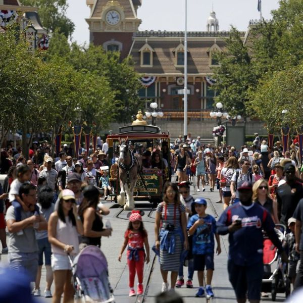 Guests are seen walking along Main Street in Disneyland in 2017. (Credit: Gary Coronado / Los Angeles Times)
