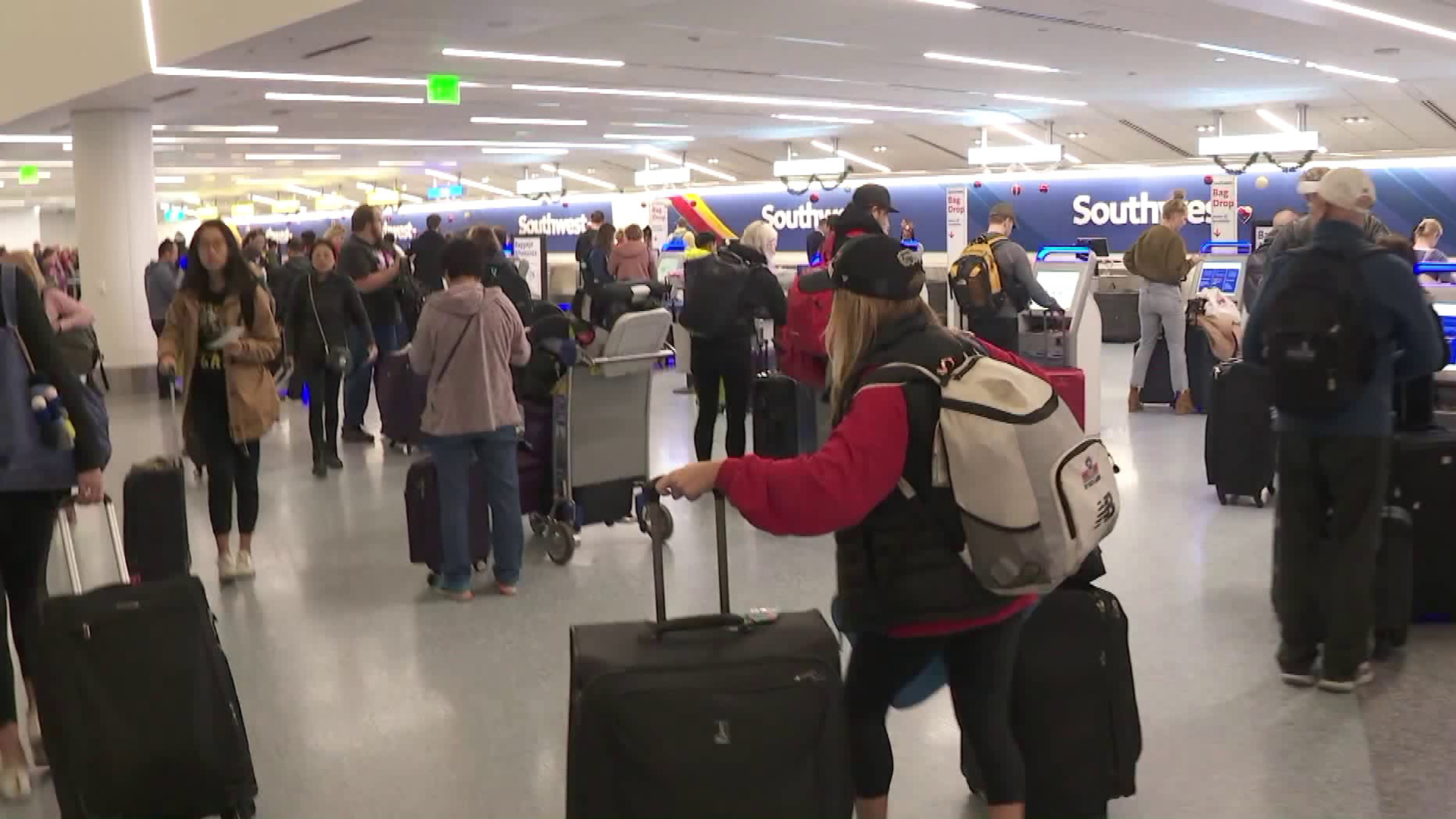 Children and surviving spouses of fallen U.S. military heroes gather at theLos Angeles International Airport before heading to Disney World on Dec. 8, 2018.(Credit: KTLA)