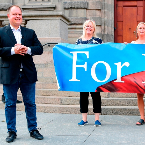 "Danish People's Partys Martin Henriksen, left, stands in front of the Danish Parliament during a demonstration organized by For Frihed - ""For Freedom"" -- in Copenhagen, Denmark, on August 1, 2018. (Credit: BAX LINDHARDT/AFP/Getty Images)"