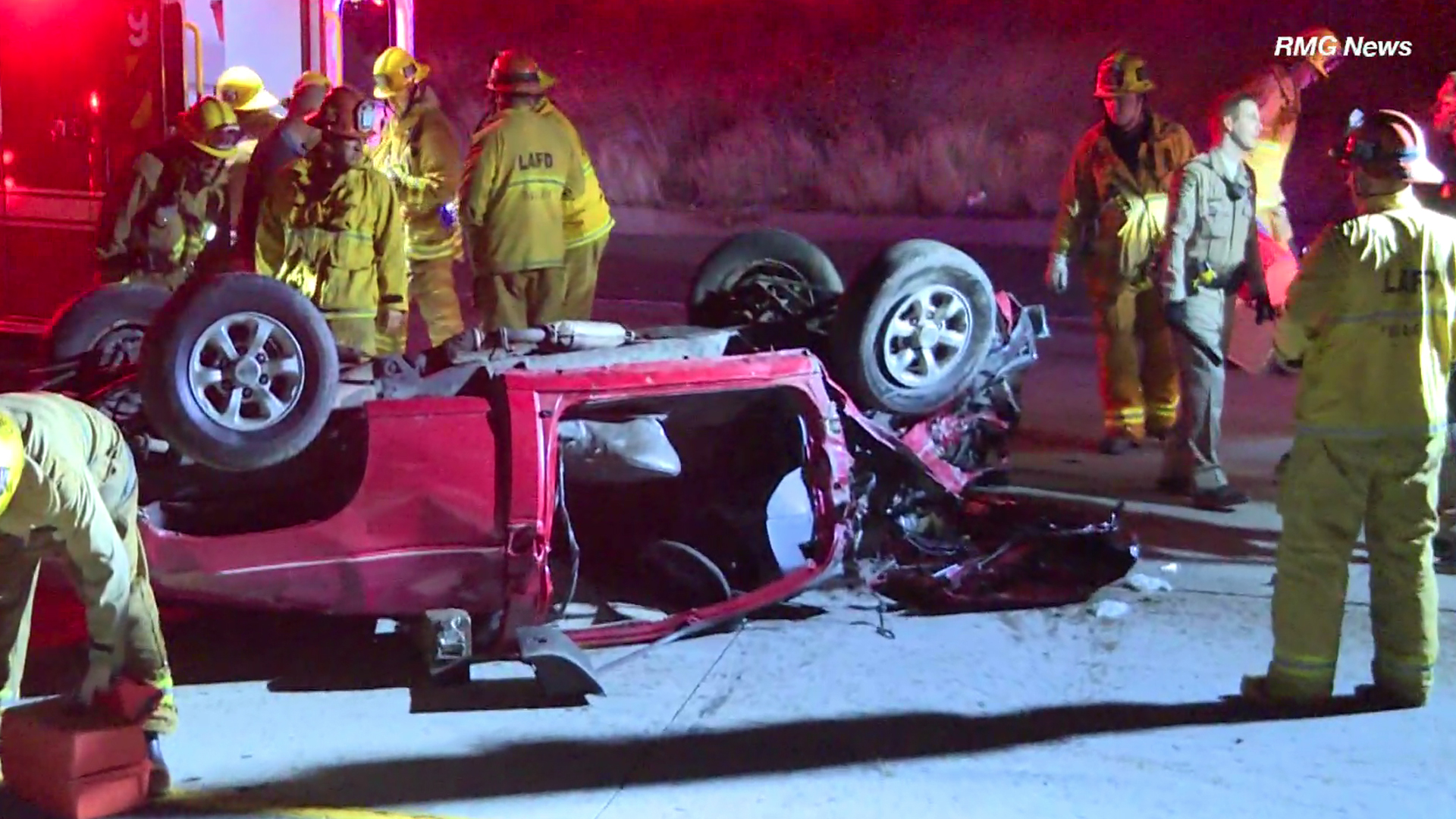 Firefighters respond to the scene of a fatal crash involving a Nissan pickup truck in Mission Hills on Dec. 9, 2018. (Credit: RMG News)