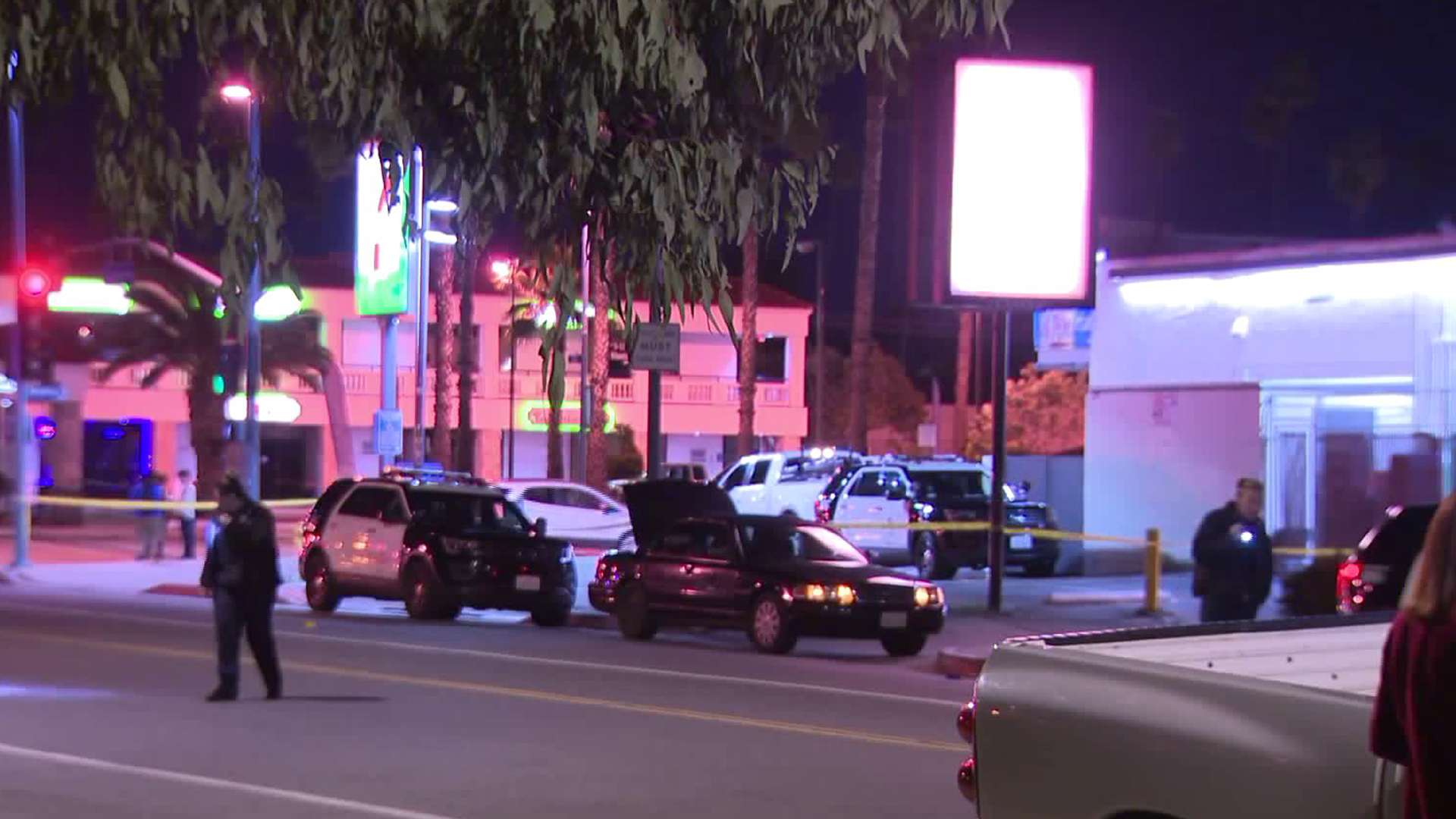 Police investigate the scene in North Hollywood where a man and woman crashed a vehicle after being shot on Dec.7, 2018. (Credit: KTLA)