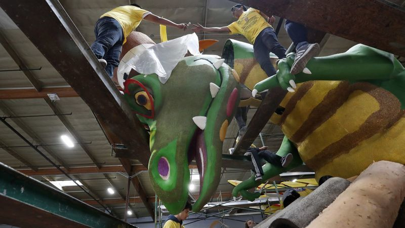 Workers in Irwindale prepare a Rose Parade float for Rotary International that will debut Jan. 1 in the 2019 Rose Parade in Pasadena on New Year's Day. A carriage fee dispute threatens KTLA Channel 5's Rose Parade coverage for Spectrum customers. (Credit: Mel Melcon / Los Angeles Times)