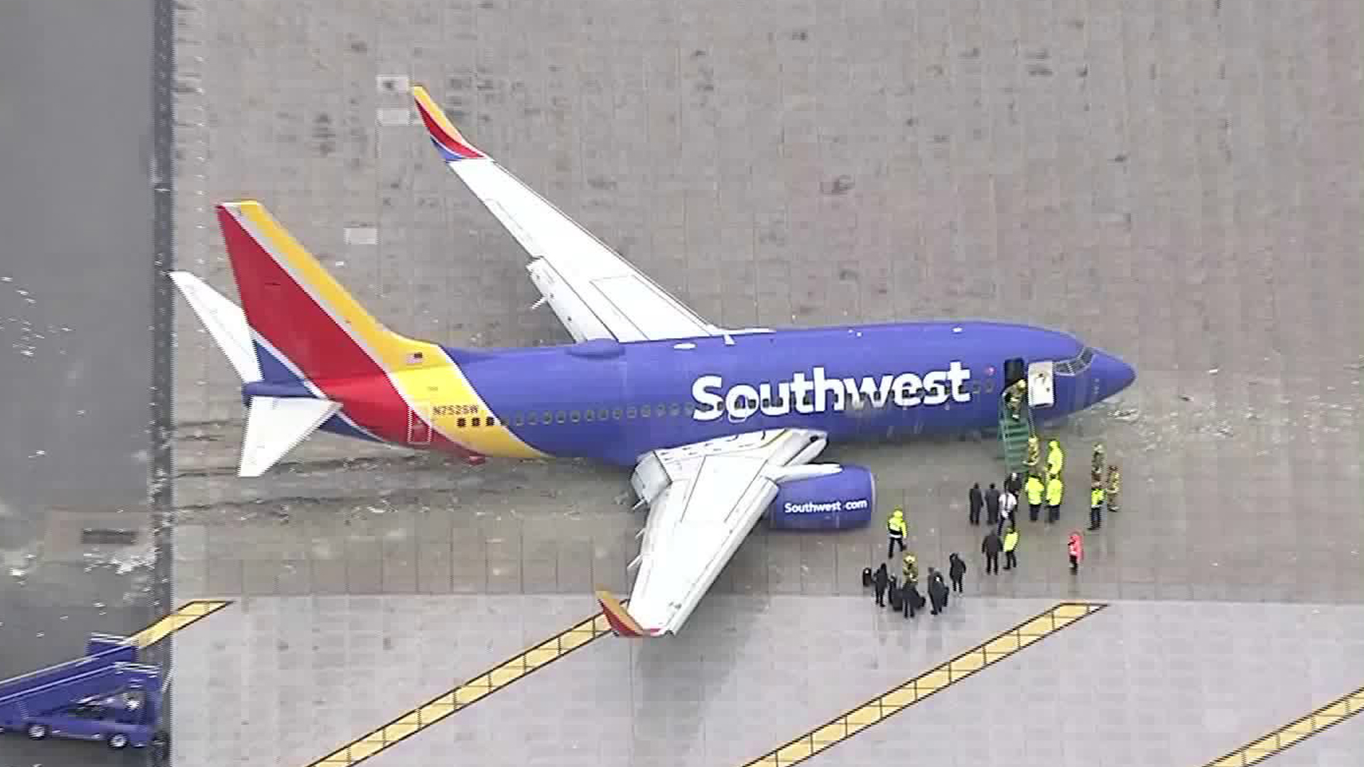 Aerial footage shows a Southwest Airline plane at Burbank Hollywood Airport after skidding off the runway on Dec. 6, 2018. (Credit: KTLA Sky 5)