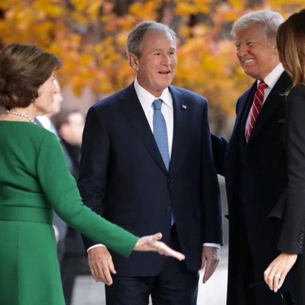 Former first lady Laura Bush and former President George W. Bush greet President Donald Trump and first lady Melania Trump outside of Blair House Dec. 4, 2018, in Washington, D.C. (Credit: Chip Somodevilla/Getty Images)