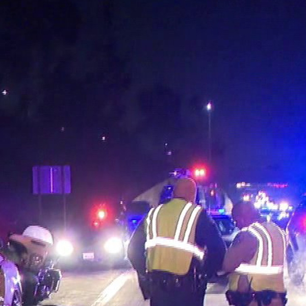 Officers investigate the scene of a hit-and-run crash along the westbound 210 Freeway in Rancho Cucamonga, on Jan. 18, 2019. (Credit: KTLA)