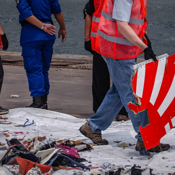 National Transportation Safety Board (NTSB) and Boeing official check debris from Lion Air flight JT 610 at the Tanjung Priok port on November 1, 2018 in Jakarta, Indonesia. (Credit: Ulet Ifansasti/Getty Images)