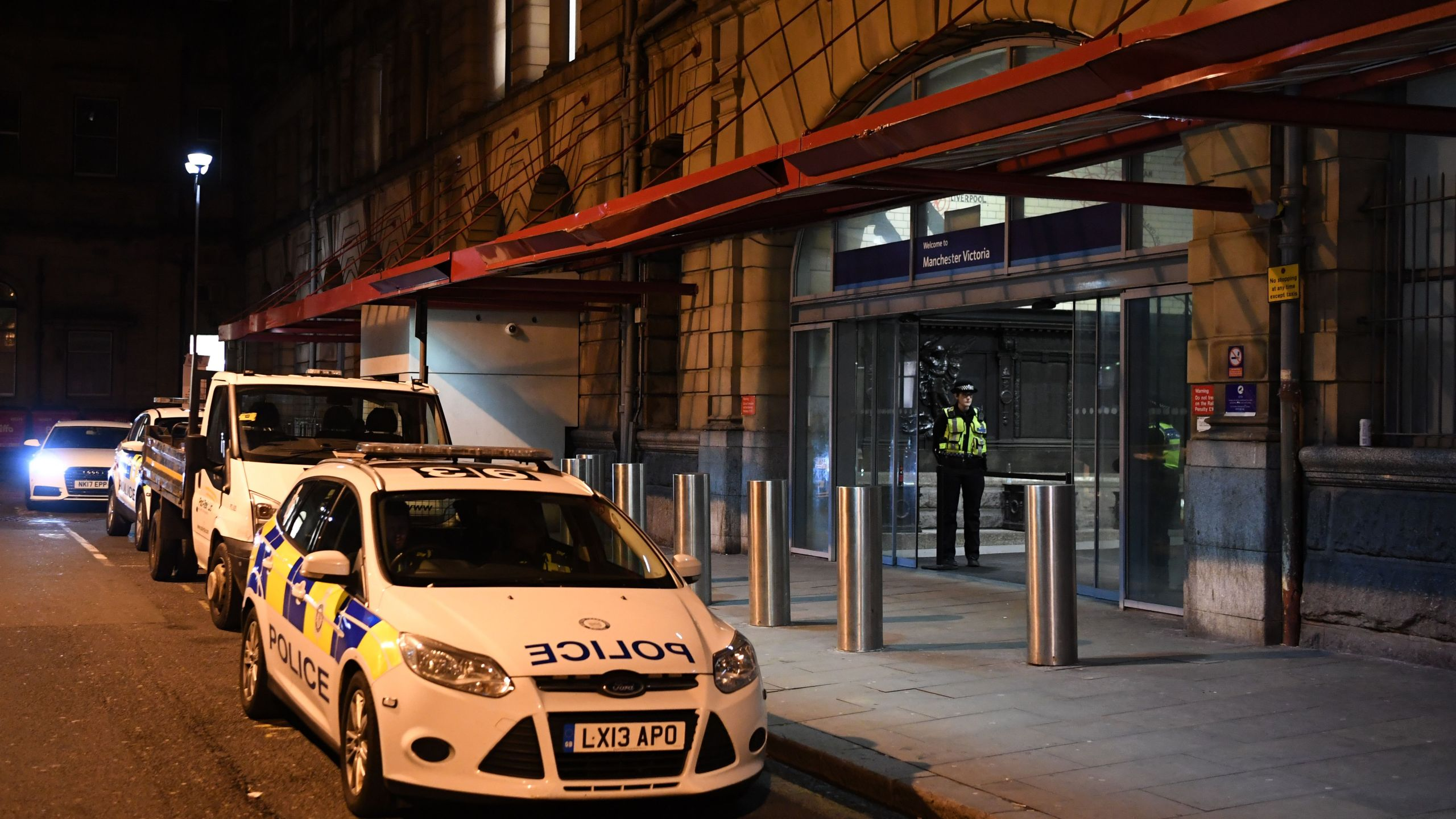 Police officers stand near a cordon at Manchester Victoria Station, in Manchester on January 1, 2019, following a stabbing on December 31, 2018. (Credit: PAUL ELLIS/AFP/Getty Images)
