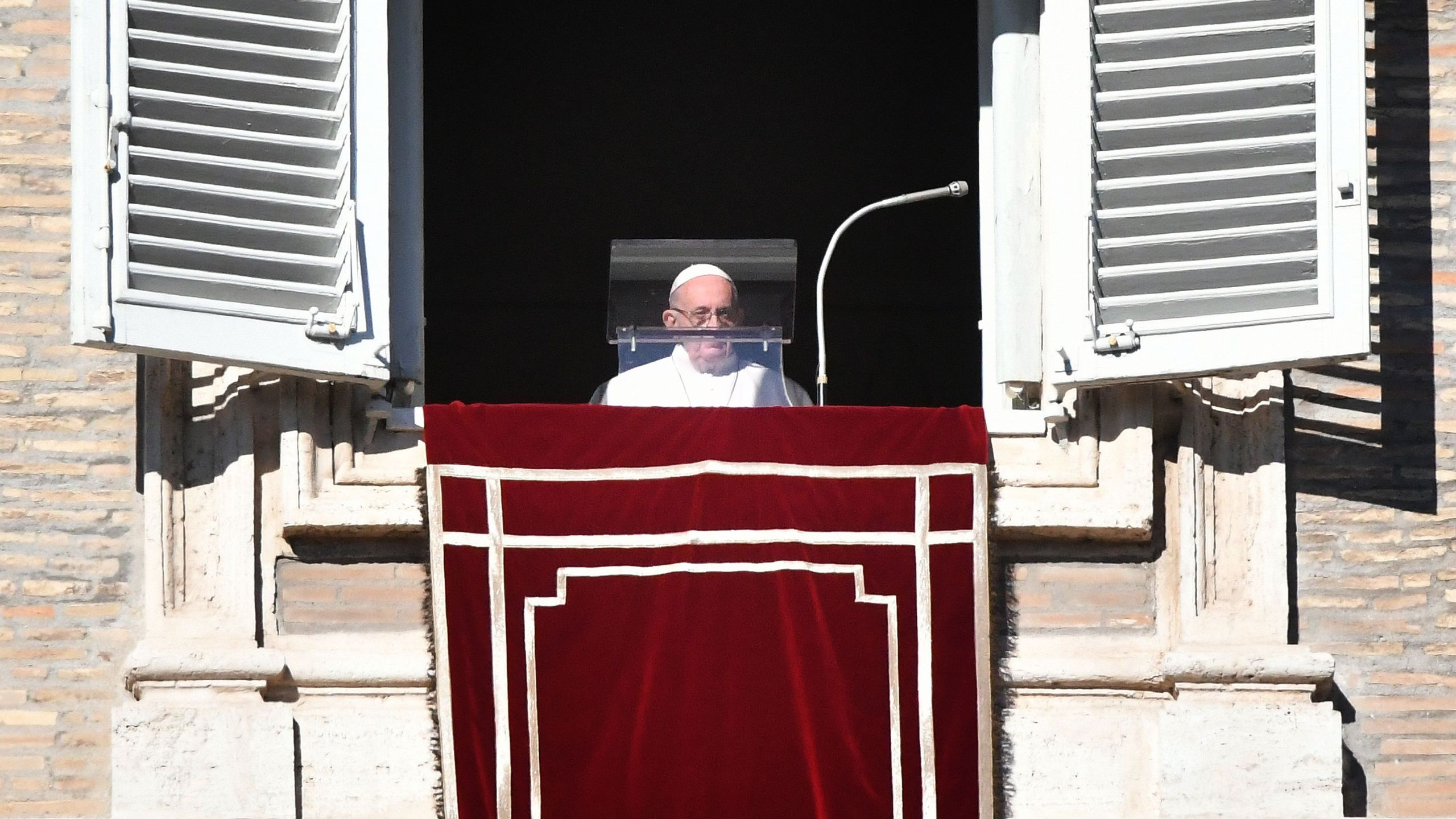Pope Francis arrives to address the crowd from the window of the Apostolic palace overlooking St. Peter's square during the New Year Angelus prayer in the Vatican on January 1, 2019. (Credit: Alberto Pizzoli/AFP/AFP/Getty Images)
