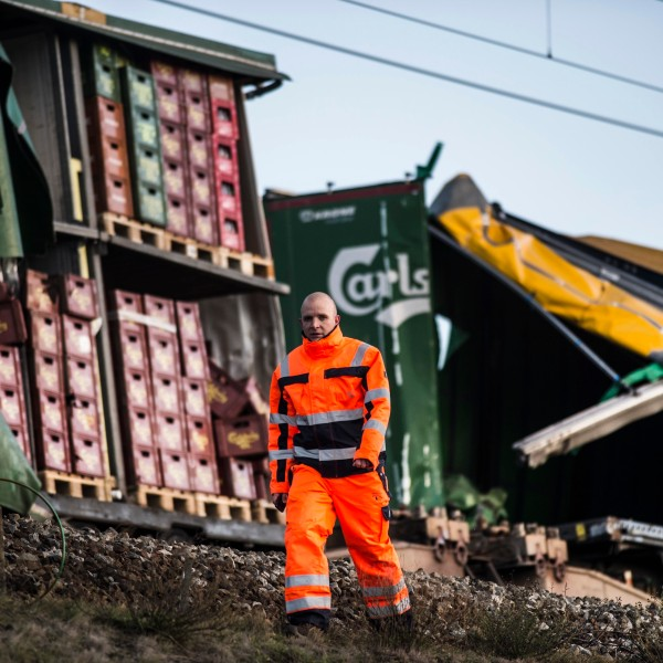 A staff member walks past damaged containers on a cargo train on the Great Belt Bridge after a railway accident on January 2, 2019 in Nyborg, Denmark. (Credit: TIM KILDEBORG JENSEN/AFP/Getty Images)