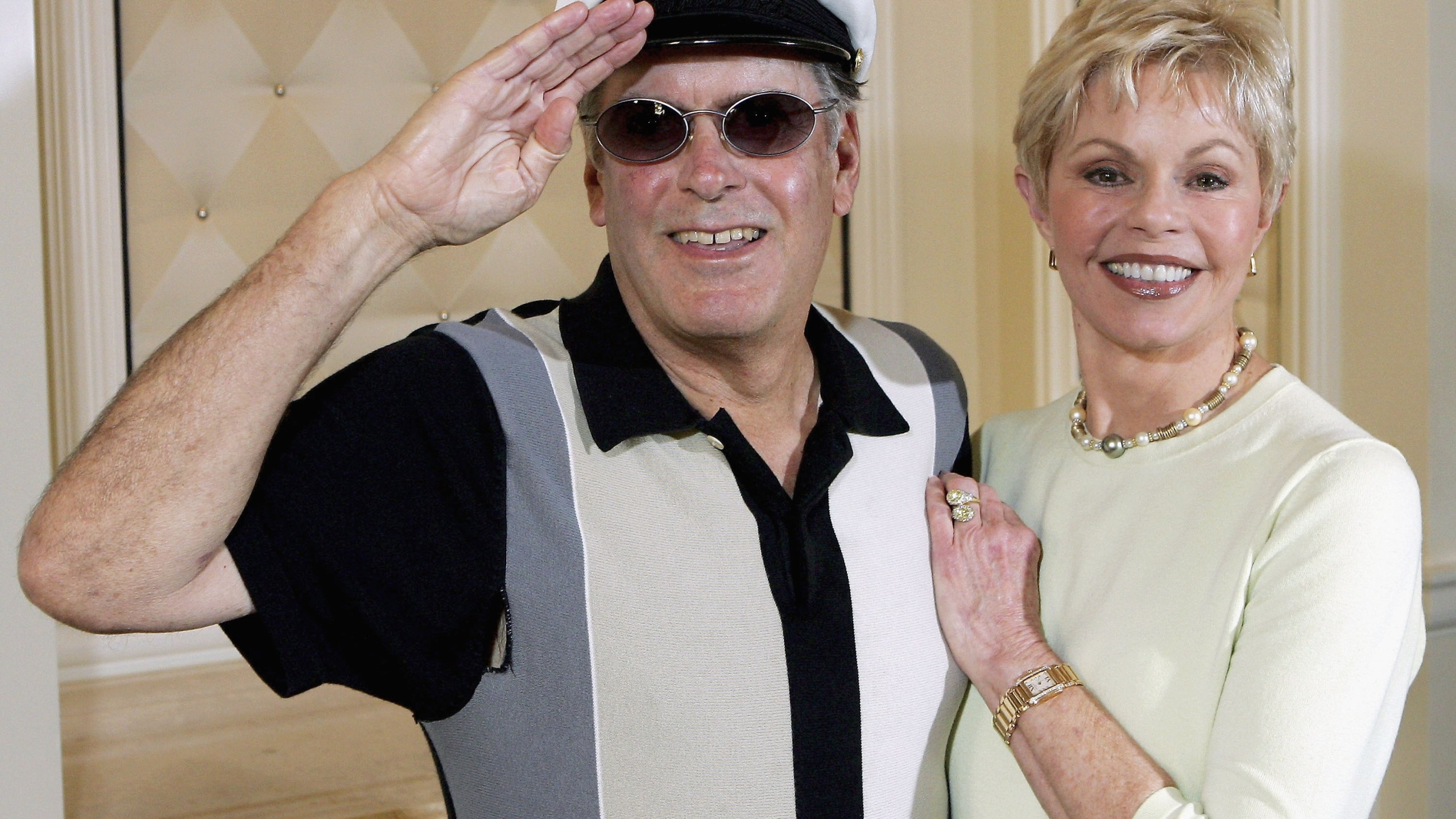 """Captain"" Daryl Dragon and his wife Toni Tennille of the music duo The Captain and Tennille, pose at the Video Software Dealers Association's annual home video convention at the Bellagio hotel in Las Vegas on July 27, 2005. (Credit: Ethan Miller/Getty Images)"