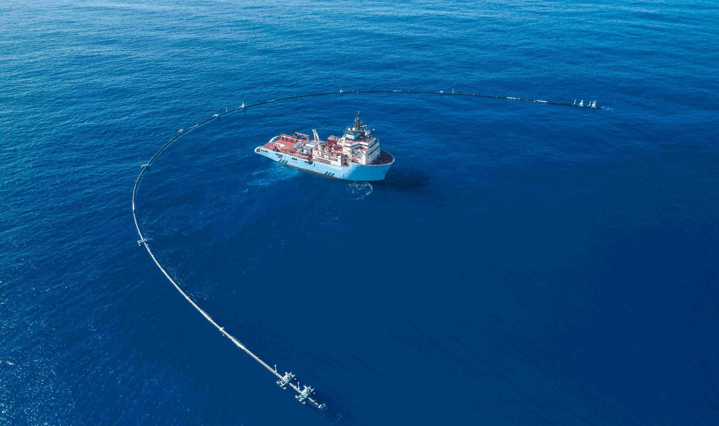 The 2,000-foot-long system created to clean up plastic pollution in the Pacific Ocean appears in an undated photo. (Credit: The Ocean Cleanup via CNN)