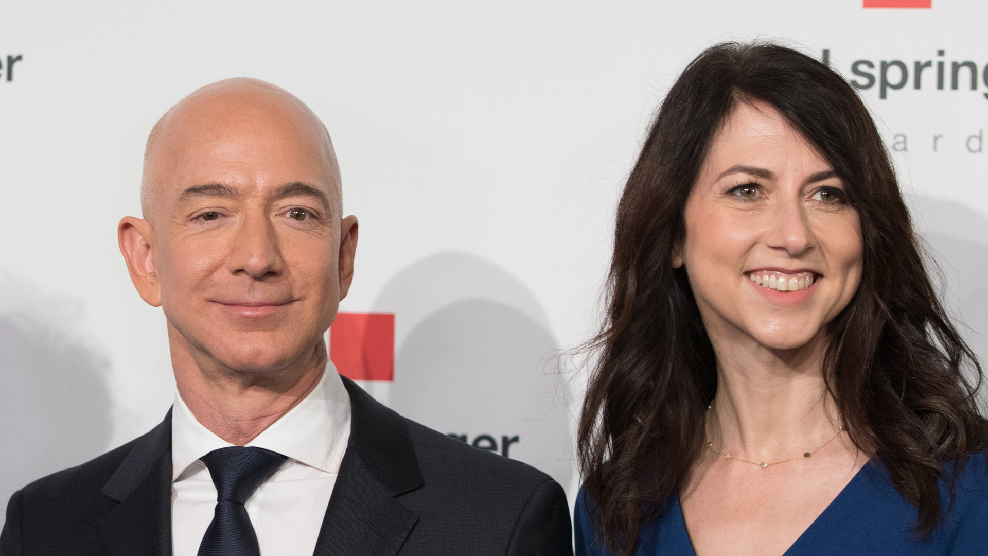Amazon CEO Jeff Bezos and his wife MacKenzie Bezos poses as they arrive at the headquarters of publisher Axel-Springer in Berlin on April 24, 2018. (Credit: Jorg Carstensen/AFP/Getty Images)