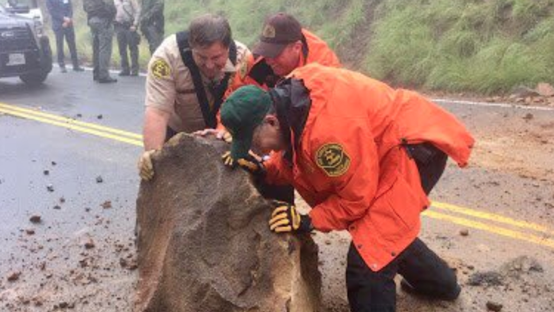 Officials are seen moving a fallen boulder on Rambla Pacifico Street in Malibu, in a photo tweeted by the Los Angeles County Sheriff's Office on Jan. 17, 2019.