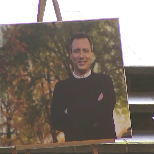 Beloved KTLA anchor and reporter Chris Burrous is pictured in a photo displayed at a memorial service held in his honor, on Jan. 11, 2019, in Whittier. He passed away on Dec. 27, 2018. (Credit: KTLA)
