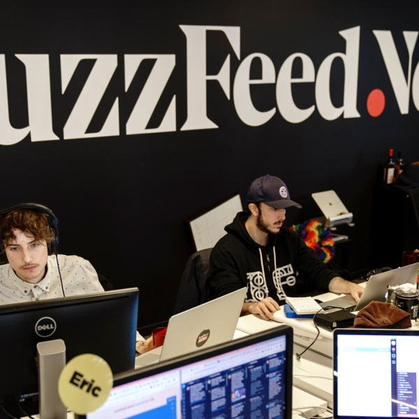 Members of the BuzzFeed News team work at their desks at BuzzFeed headquarters, Dec. 11, 2018, in New York City. BuzzFeed is an American internet media and news company that was founded in 2006. (Credit: Drew Angerer/Getty Images)