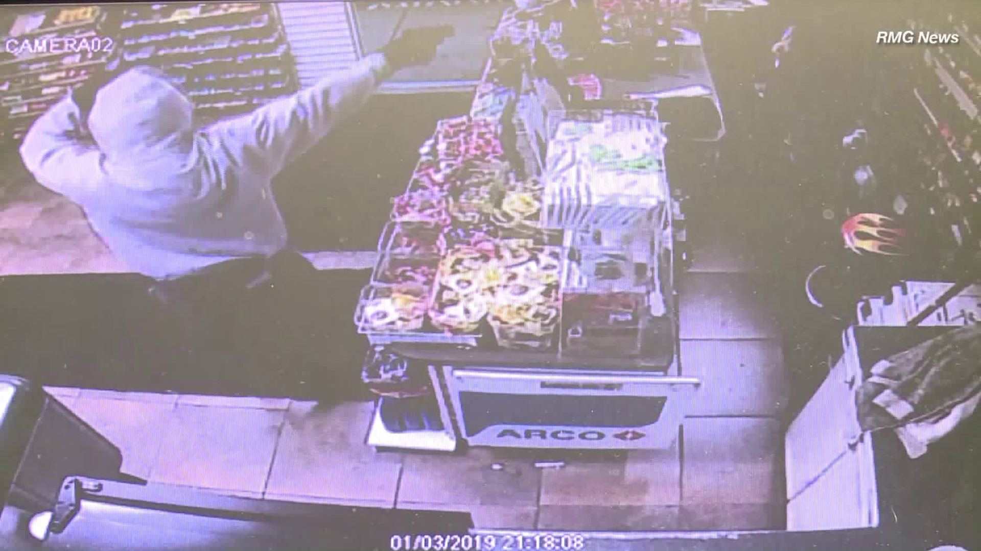 A surveillance image shows a gunman holding up an Arco station in Carson on Jan. 3, 2018.