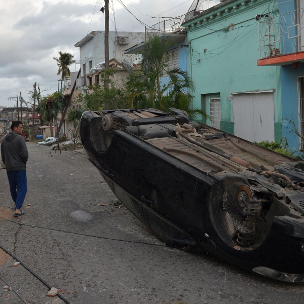 A car lies upside-down amid the street after the passage of a tornado in Havana, Cuba, on January 28, 2019. (Credit: YAMIL LAGE/AFP/Getty Images)