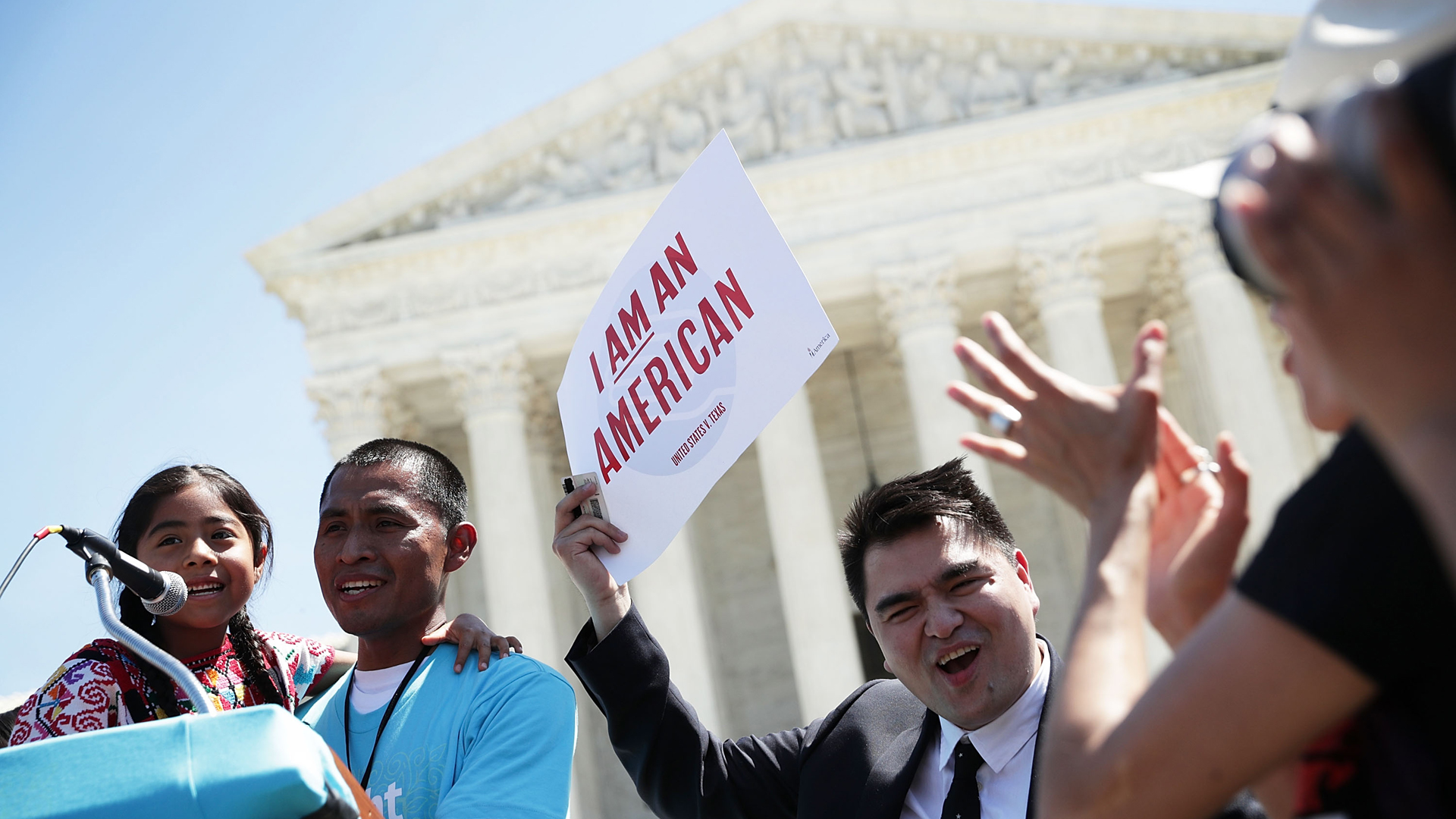 Six-year-old Sophie Cruz, left, speaks during a rally in front of the U.S. Supreme Court next to her father Raul Cruz and supporter Jose Antonio Vargas, right, on April 18, 2016 in Washington, DC. The Supreme Court heard oral arguments in the case of United States v. Texas, which is challenging President Obama's 2014 executive actions on immigration - the Deferred Action for Children Arrivals (DACA) and Deferred Action for Parents of American and Lawful Permanent Residents (DAPA) programs. (Credit: Alex Wong/Getty Images)