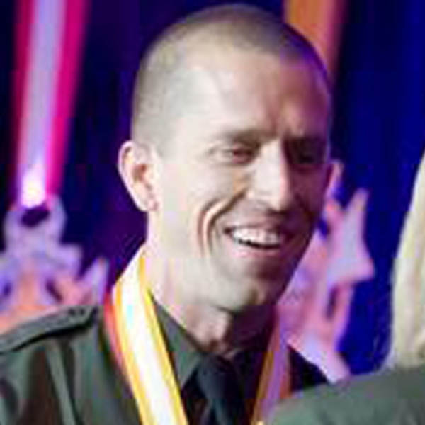 In 2014, Orange County Sheriff's Deputy Michael Higgins shakes hands with Sheriff Sandra Hutchens as he accepts the Medal of Valor in Irvine. (Credit: Orange County Register)