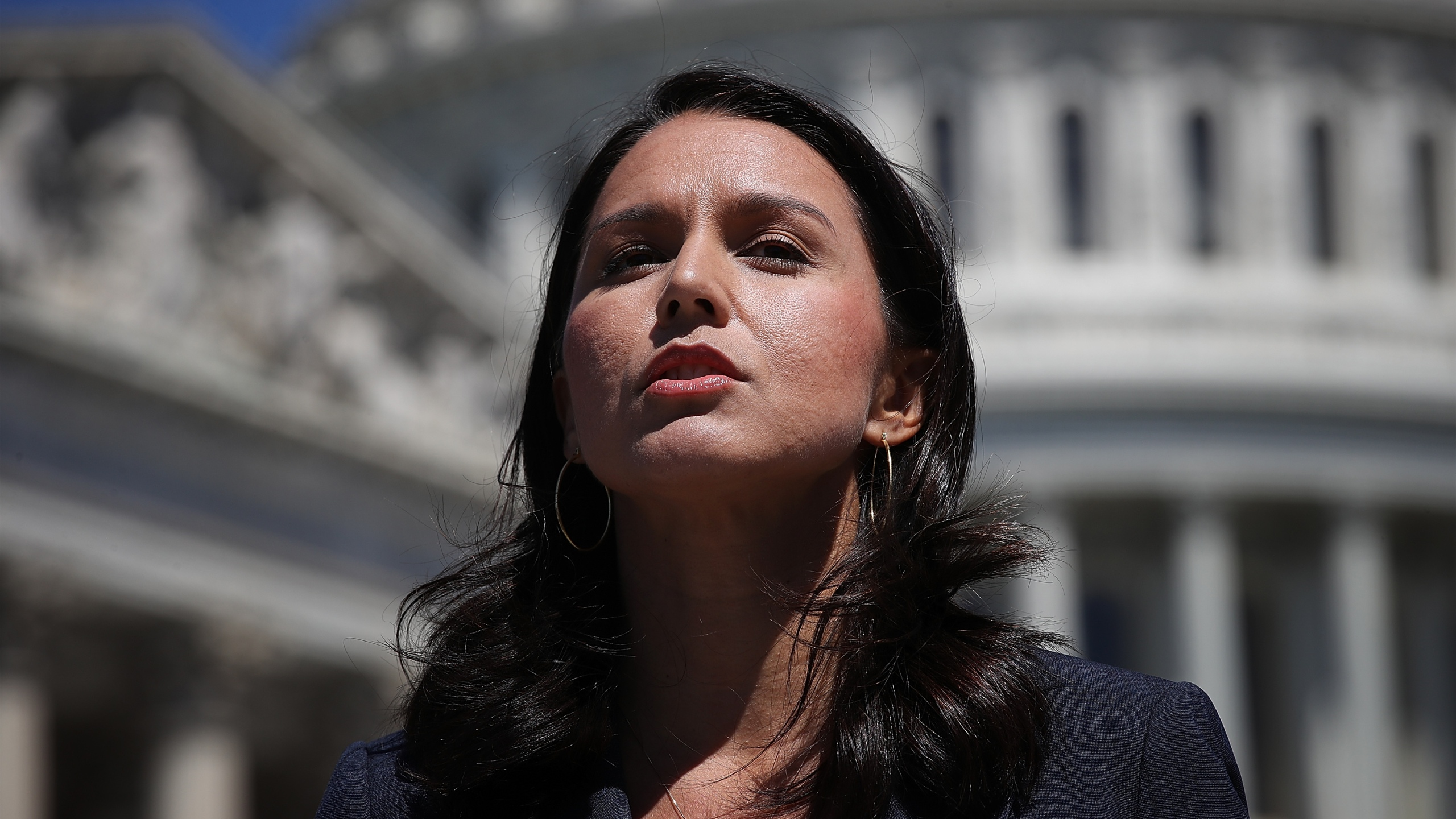 Rep. Tulsi Gabbard (D-HI) speaks at a press conference on House Resolution 922 outside the U.S. Capitol July 18, 2018 in Washington, DC. (Credit: Win McNamee/Getty Images)