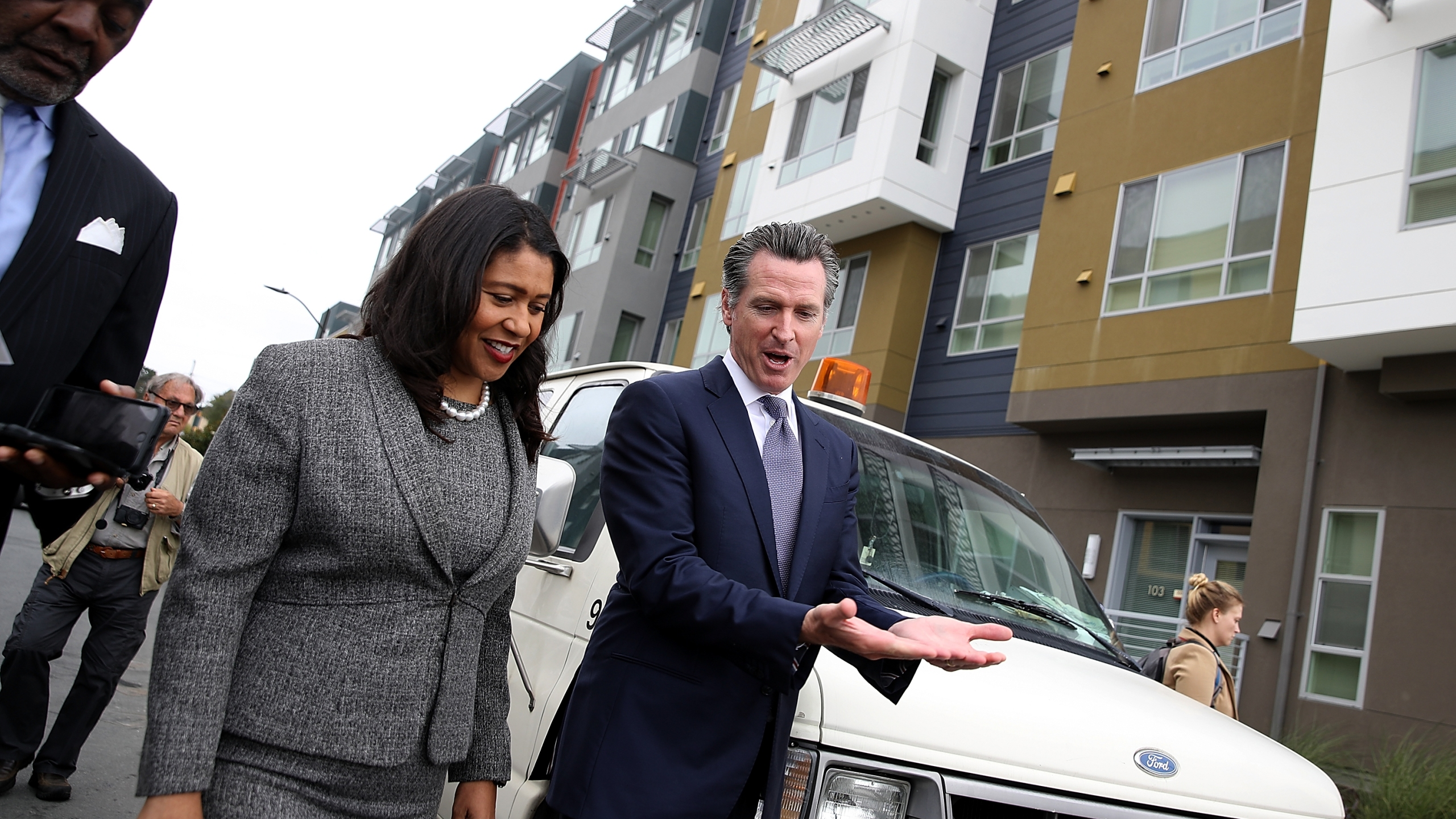 Gavin Newsom talks with San Francisco mayor London Breed as they visit the Alice Griffith Apartments on Aug. 22, 2018 in San Francisco. (Credit: Justin Sullivan/Getty Images)
