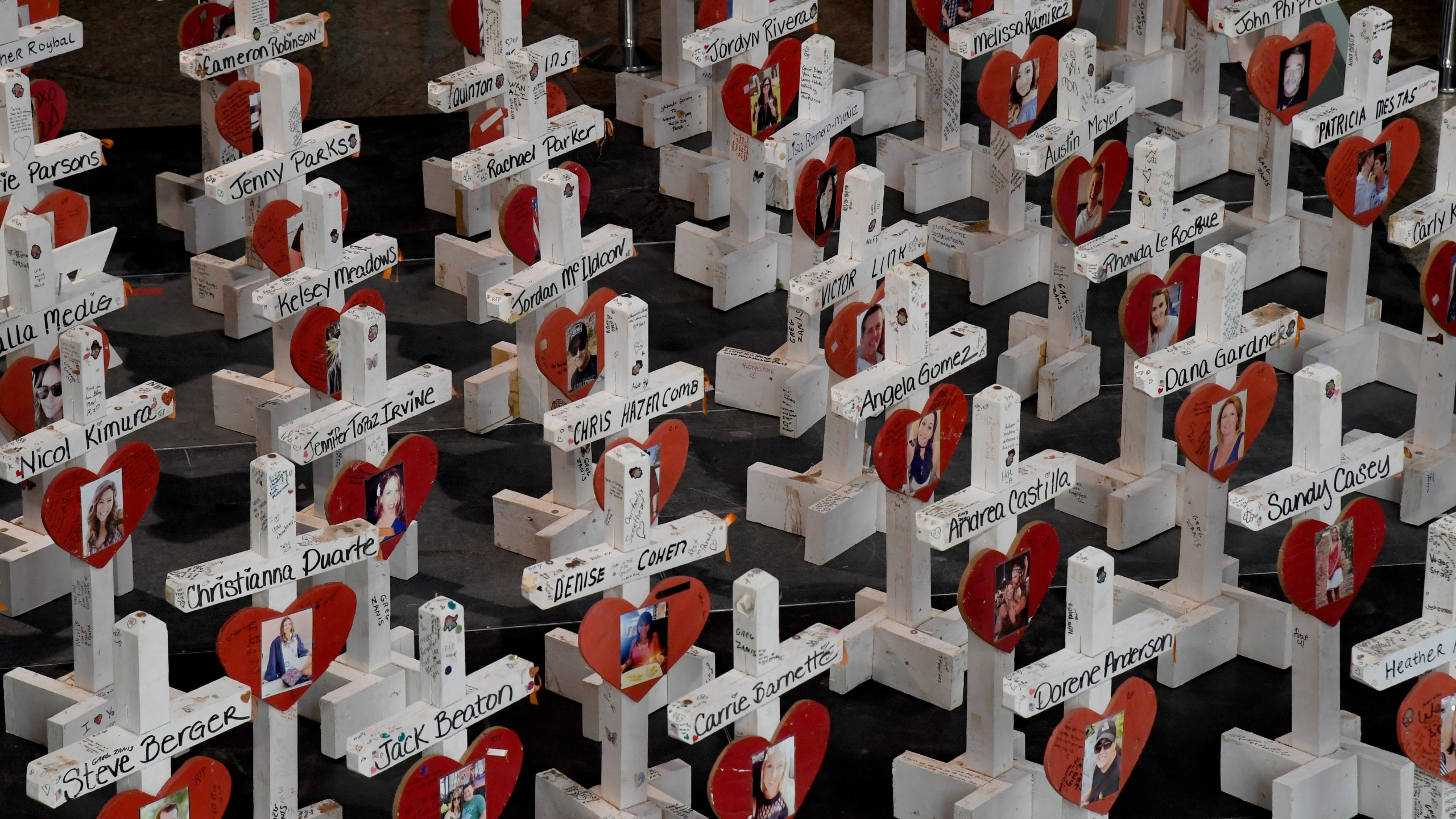 """Some of the original 58 wooden crosses that were set up as part of a memorial at the Welcome to Fabulous Las Vegas sign after last year's massacre are displayed at """"The Las Vegas Portraits Project, 1 October Memorial Exhibit"""" at the Clark County Government Center in Las Vegas on Oct. 1, 2018. (Credit: Ethan Miller / Getty Images)"""