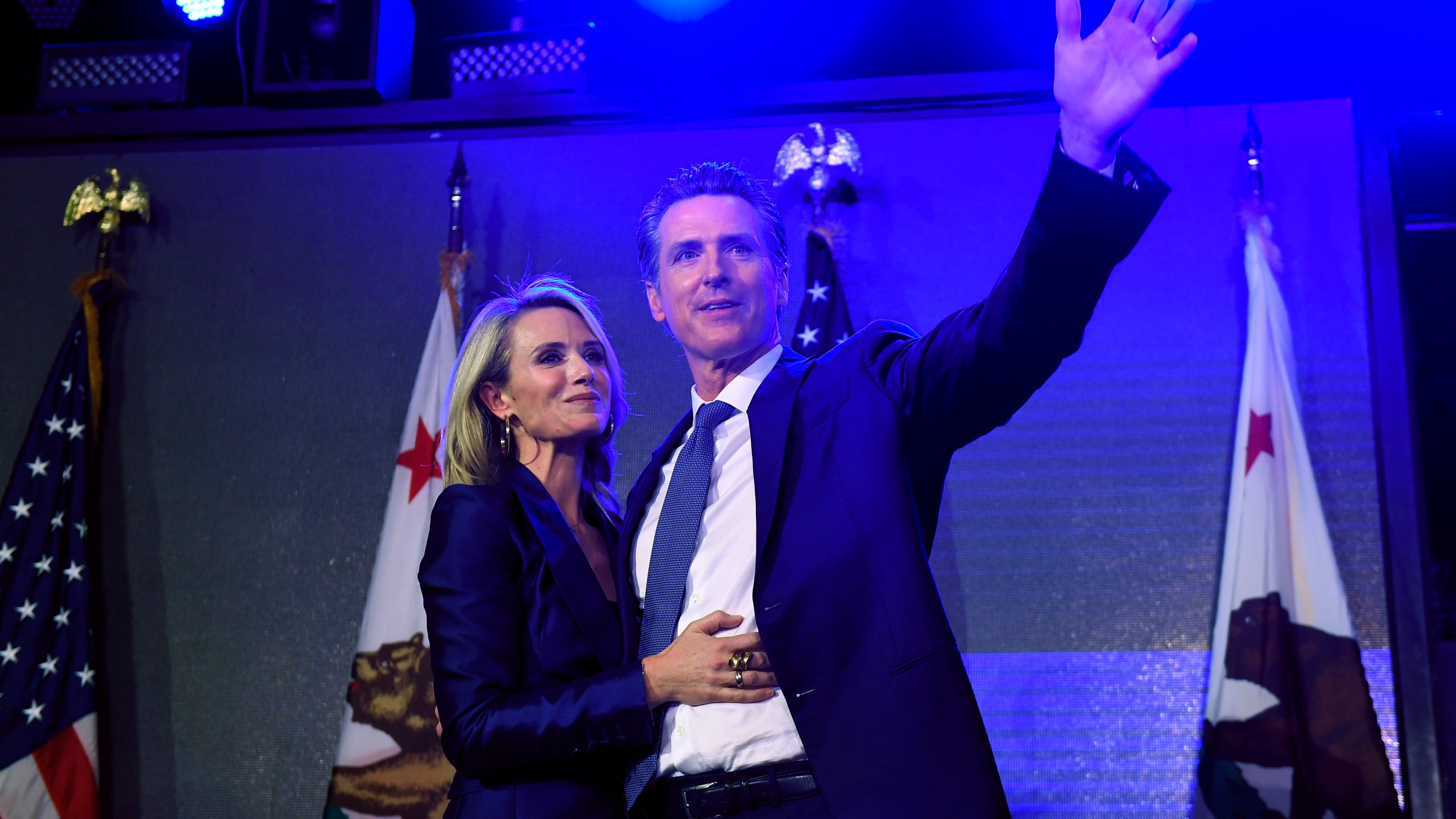 Gavin Newsom stands by his wife, Jennifer Siebel Newsom, as he waves to supporters during an election night event on Nov. 6, 2018 in Los Angeles. (Credit: Kevork Djansezian/Getty Images)