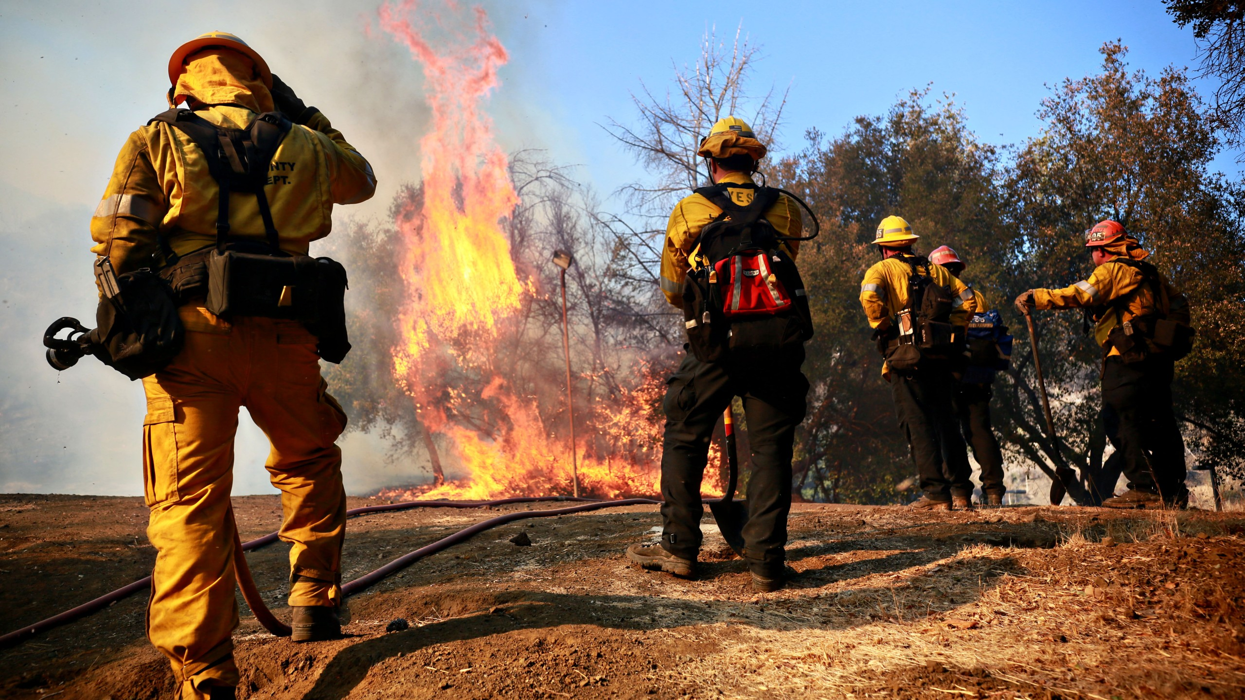 Firefighters battle a blaze at the Salvation Army Camp on November 10, 2018 in Malibu, California. (Credit: Sandy Huffaker/Getty Images)