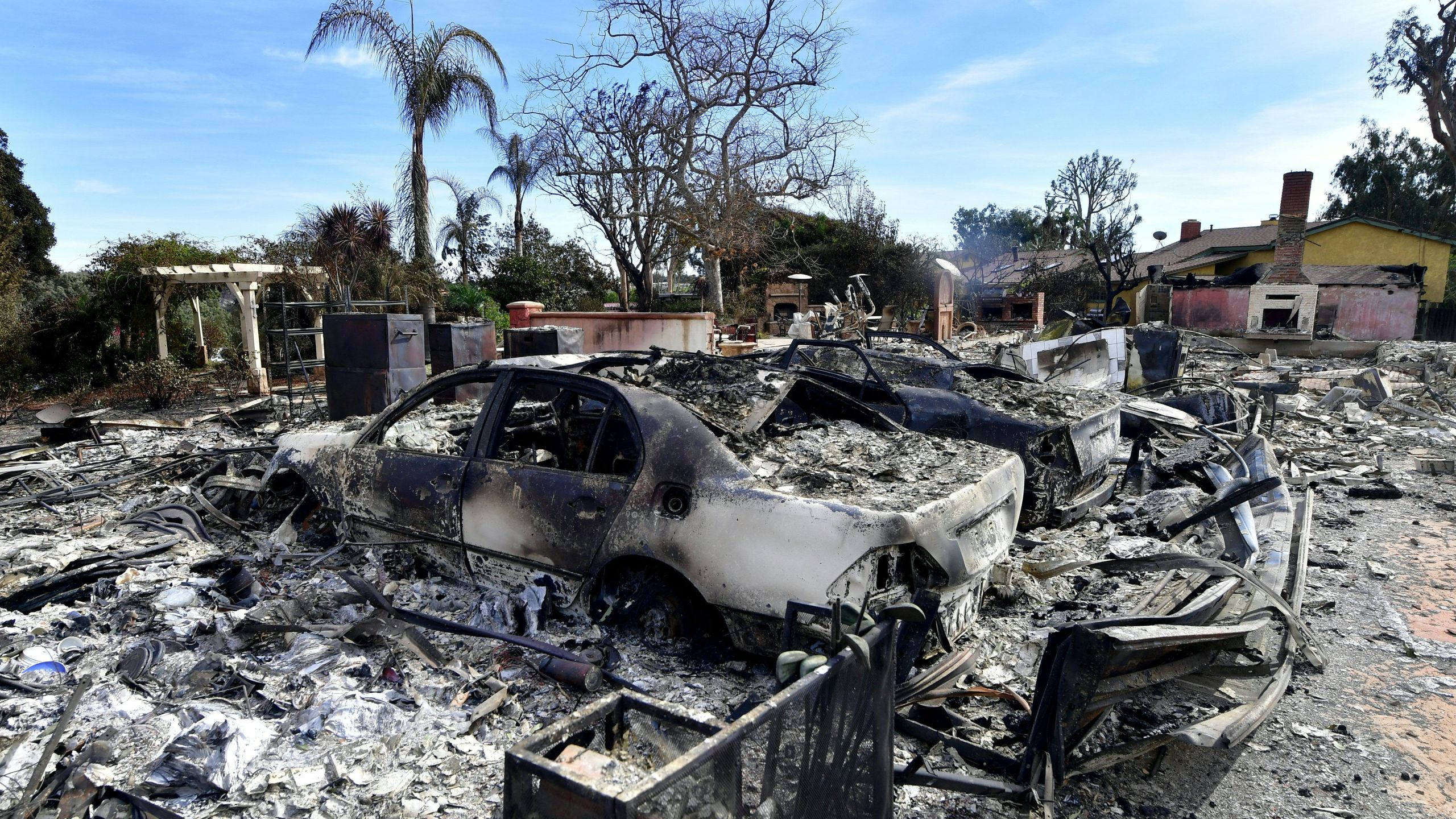 The remains of burnt down homes and vehicles resulting from the Woolsey Fire are seen on Busch Drive in Malibu on November 13, 2018. -. (Credit: FREDERIC J. BROWN/AFP/Getty Images)