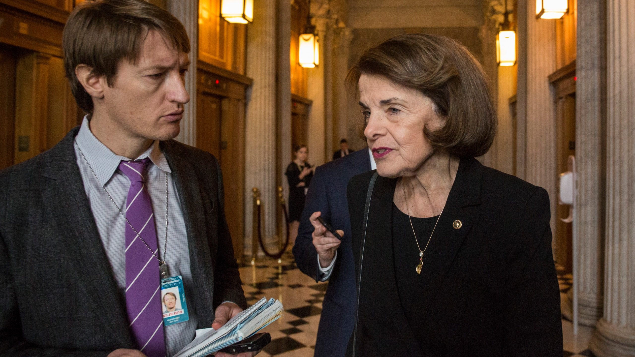 Sen. Dianne Feinstein speaks to a reporter on her way to a policy luncheon meeting at the Capitol Building in Washington, D.C., on Dec. 4, 2018. (Credit: Zach Gibson / Getty Images)