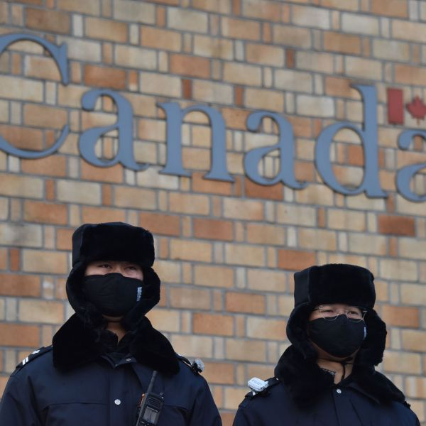 Chinese police officers stand guard outside the Canadian embassy in Beijing on December 10, 2018. (Credit: GREG BAKER/AFP/Getty Images)