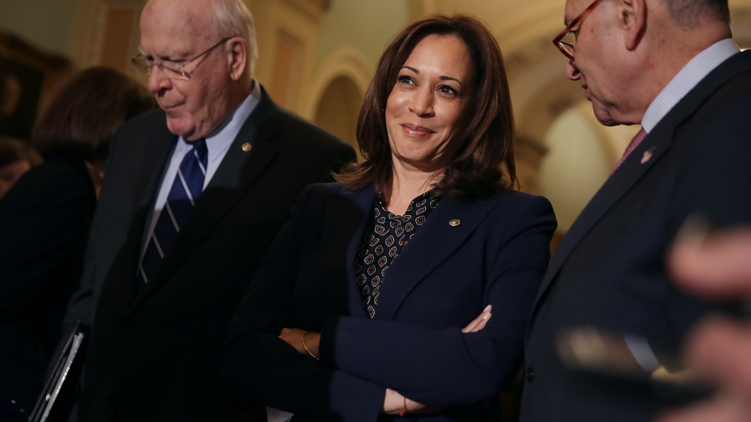 Sen. Kamala Harris stand between Sen. Patrick Leahy (D-VT) and Sen. Charles Schumer (D-NY) as they talk to reporters following the weekly Democratic Senate policy luncheon in the U.S. Capitol on Nov. 27, 2018 in Washington, D.C. (Credit: Chip Somodevilla/Getty Images)