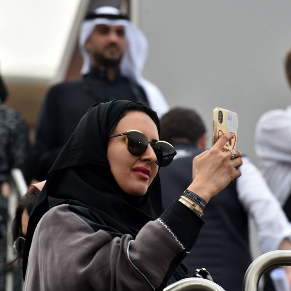 A Saudi woman takes photographs with her phone at the E-Prix Formula E Championship in Riyadh, on Dec. 15, 2018. (Credit: Fayez Nuerldine/AFP/Getty Images)