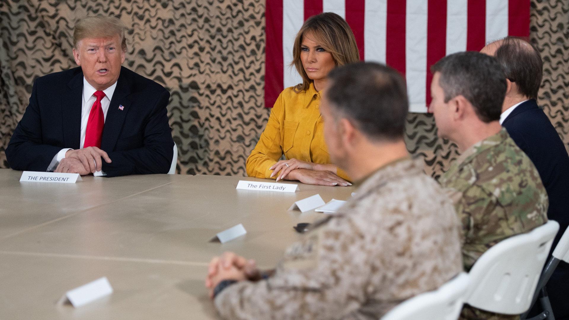 President Donald Trump and First Lady Melania Trump attend a military briefing during an unannounced trip to Al Asad Air Base in Iraq on Dec.26, 2018.(Credit: Saul Loeb/AFP/Getty Images)