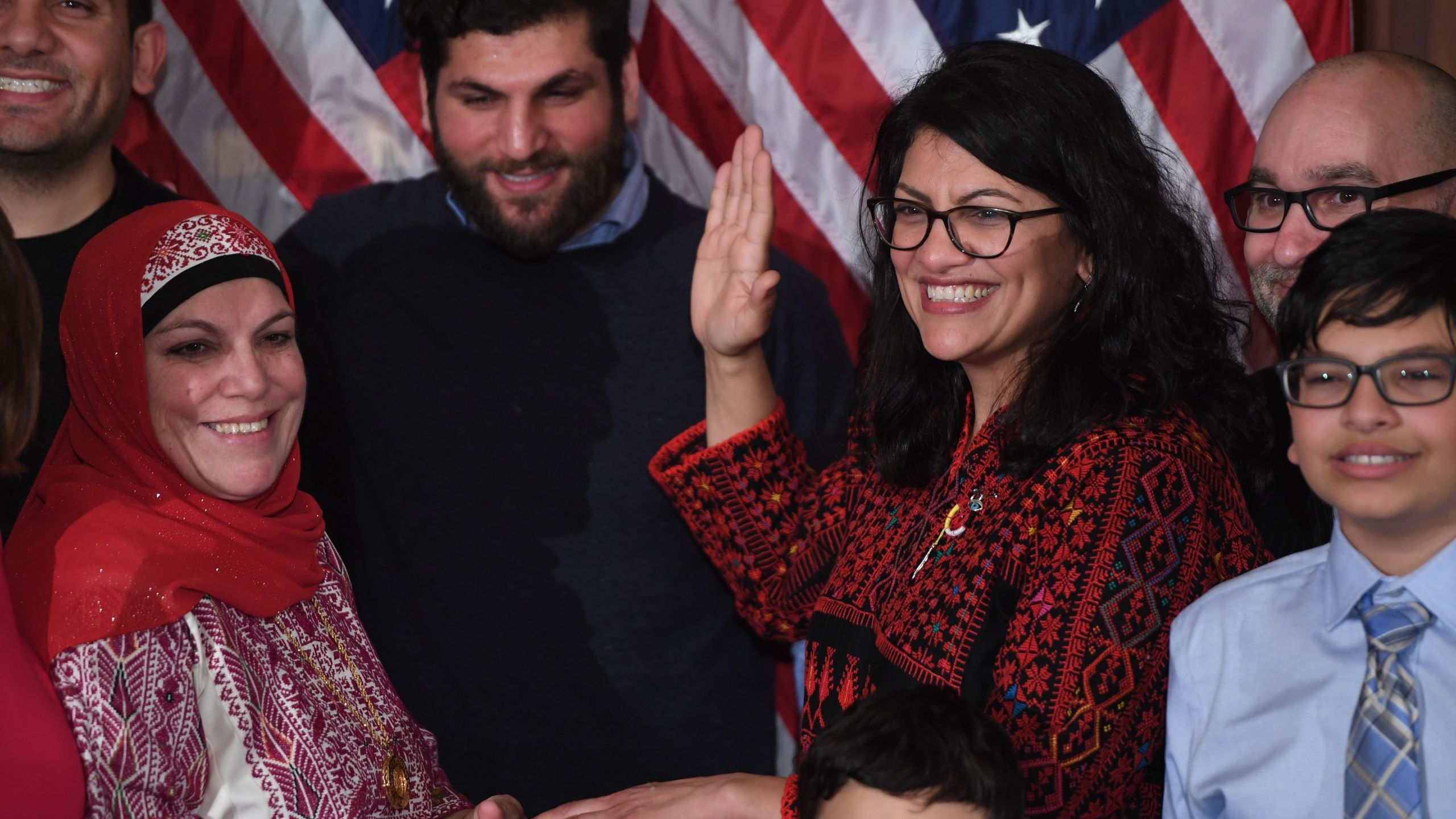 US House Representative Rashida Tlaib (D-MI), wearing a traditional Palestinian robe, takes the oath of office at the start of the 116th Congress at the US Capitol in Washington, DC, January 3, 2019. (Credit: SAUL LOEB/AFP/Getty Images)