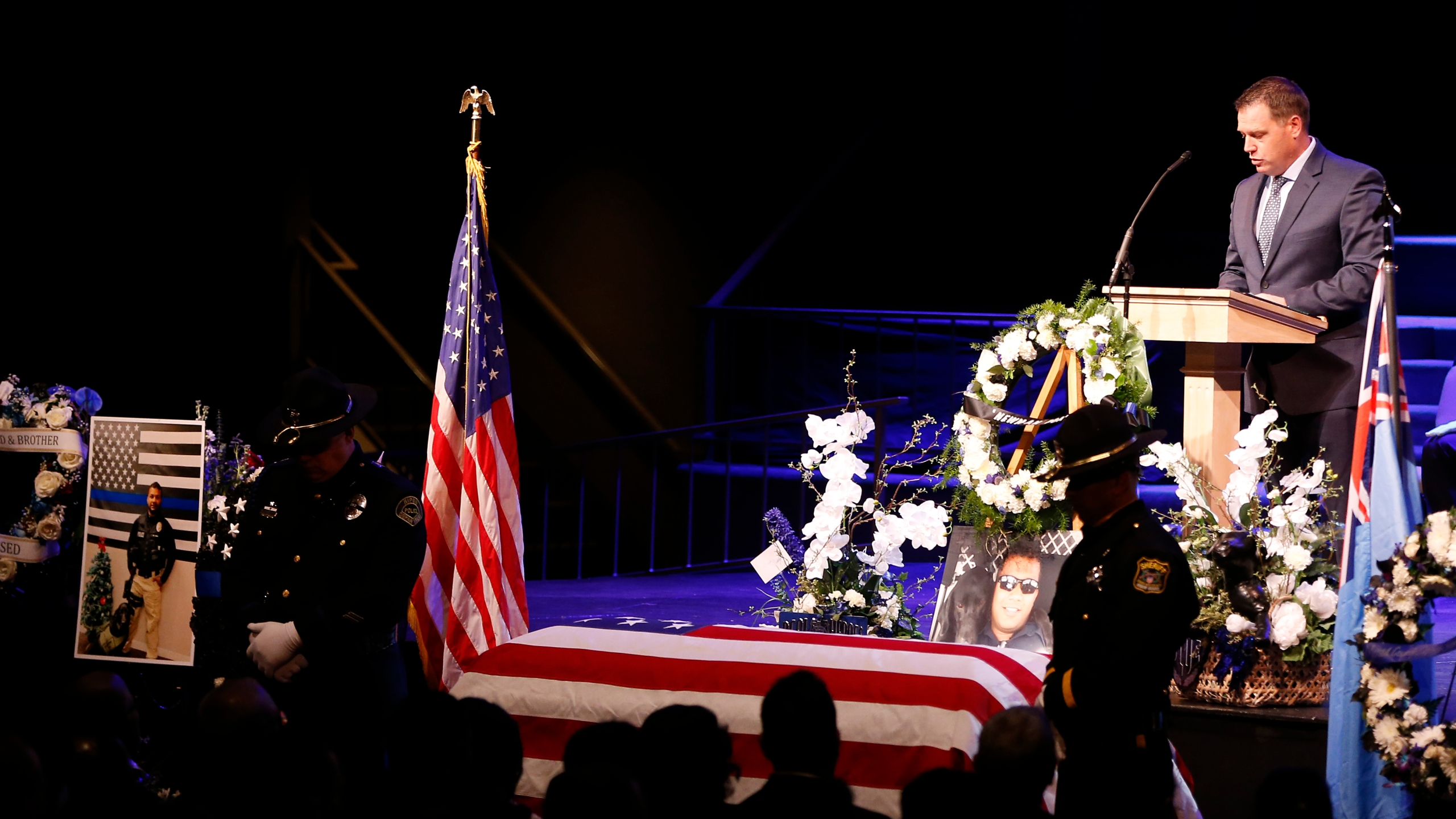 Officer Jeffrey Harmon of the Modesto Police Department speaks as the flag-draped casket of slain Newman police officer Ronil Singh is seen during a funeral service at CrossPoint Community Church on Jan. 5, 2019, in Modesto. (Credit: Stephen Lam/Getty Images)