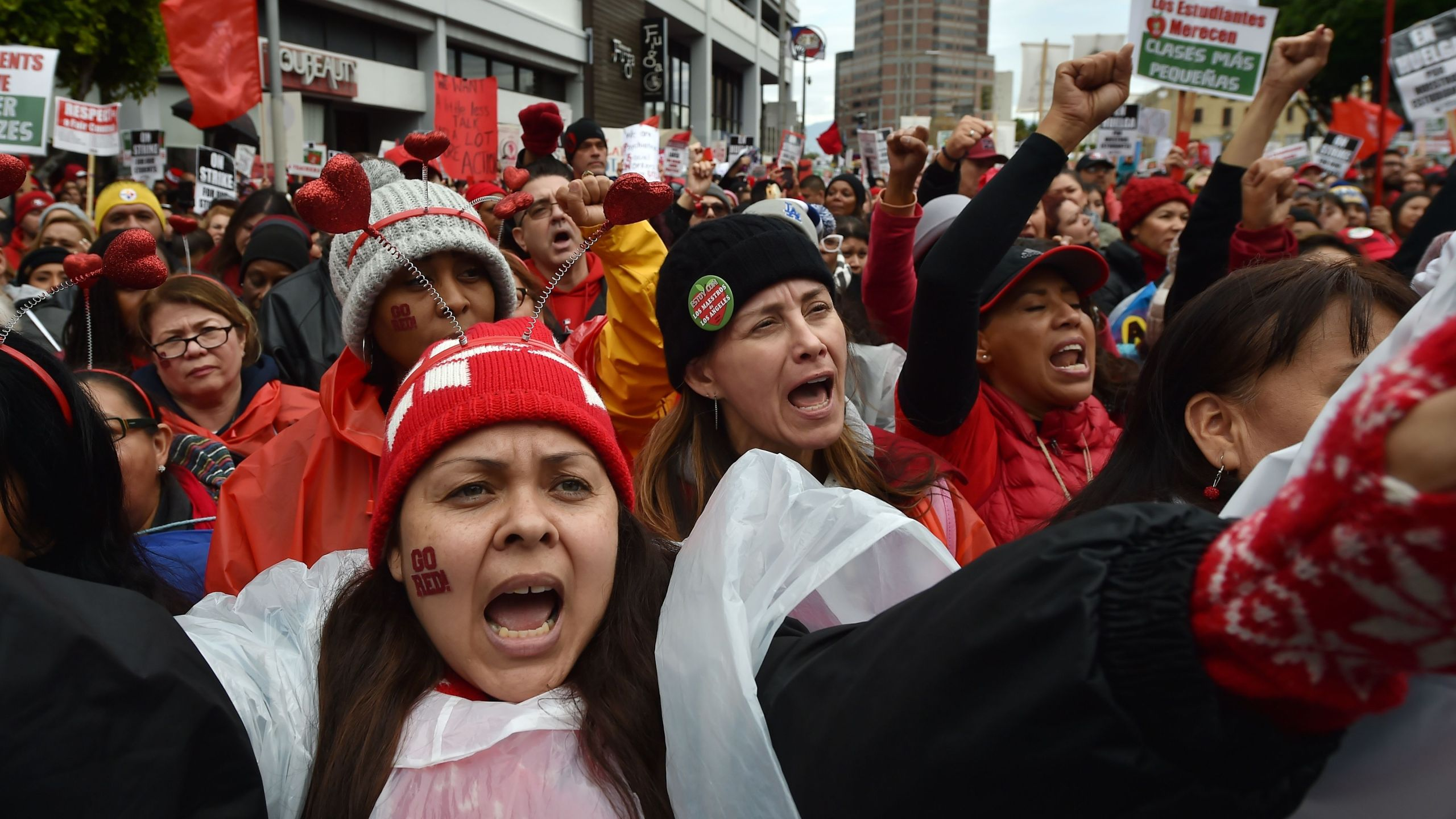 Striking teachers and their supporters rally in downtown Los Angeles on the second day of the teachers strike on Jan. 15, 2019. (Credit: Robyn Beck / AFP / Getty Images)