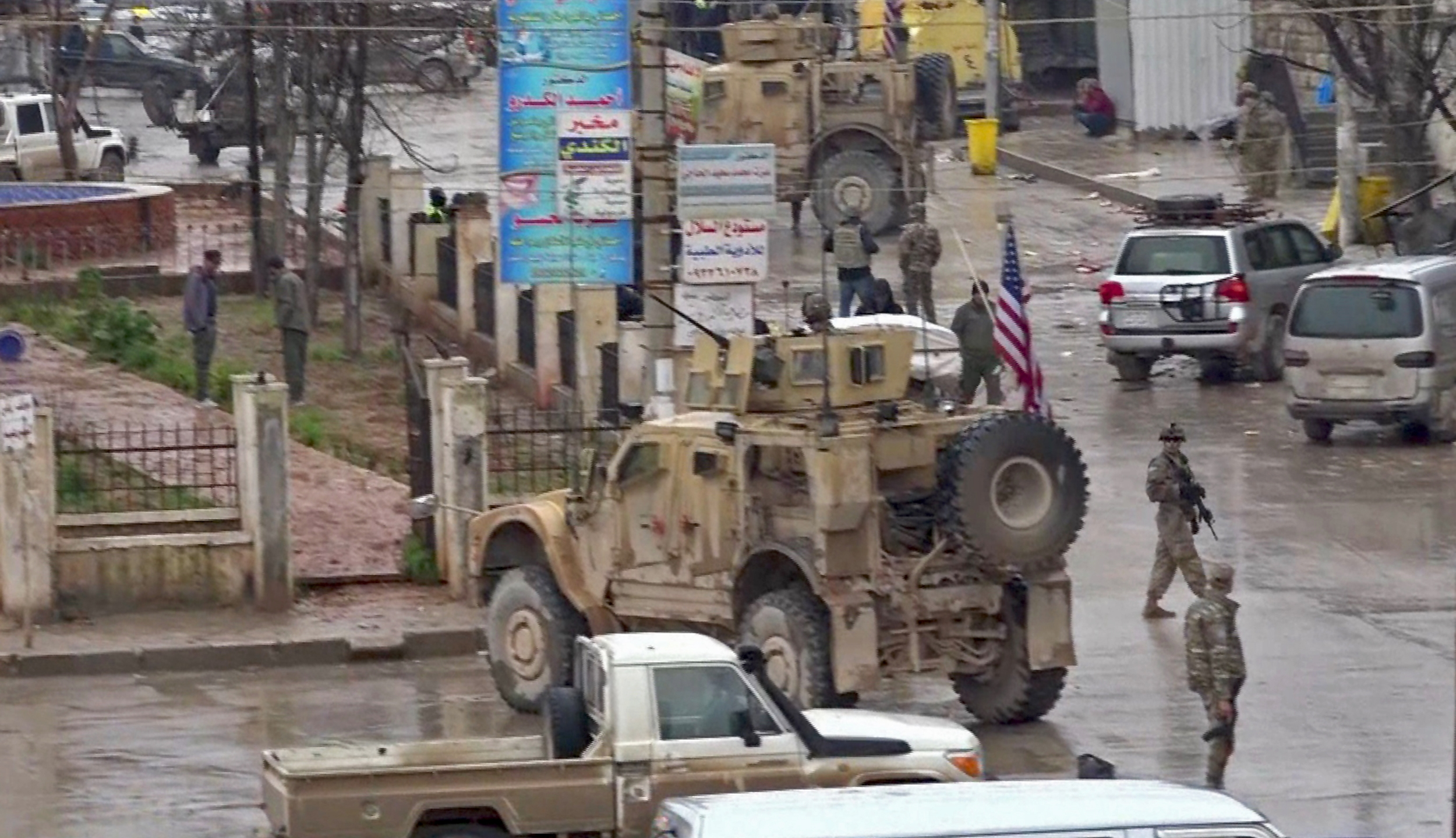 An image grab taken from a video obtained by AFPTV on Jan. 16, 2019, shows U.S. troops gathered at the scene of a suicide attack in the northern Syrian town of Manbij. (Credit: AFP/Getty Images)